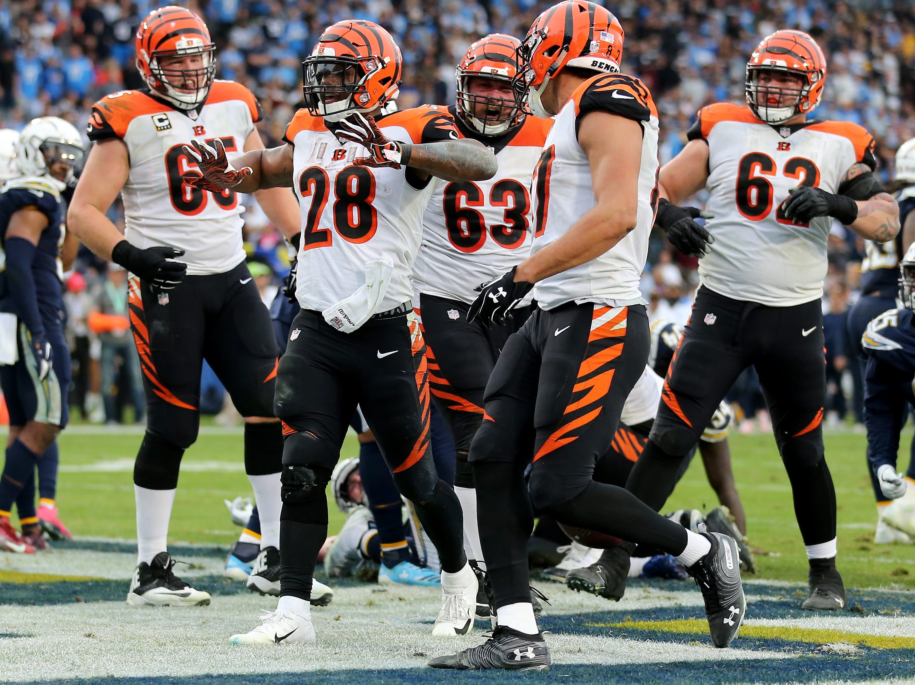 Cincinnati Bengals running back Joe Mixon (28) celebrated a touchdown run in the fourth quarter of a Week 14 NFL football game against the Los Angeles Chargers, Sunday, Dec. 9, 2018, at StubHub Center in Carson, California. The Los Angeles Chargers won 26.21.