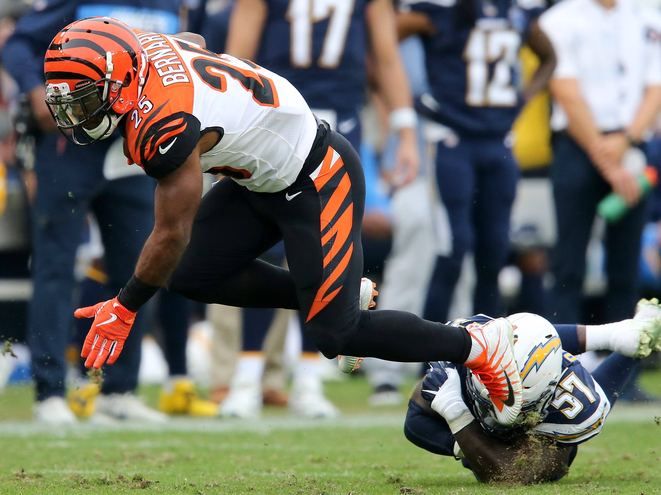 Cincinnati Bengals running back Giovani Bernard (25) is tackled by Los Angeles Chargers outside linebacker Jatavis Brown (57) in the fourth quarter of a Week 14 NFL football game, Sunday, Dec. 9, 2018, at StubHub Center in Carson, California.