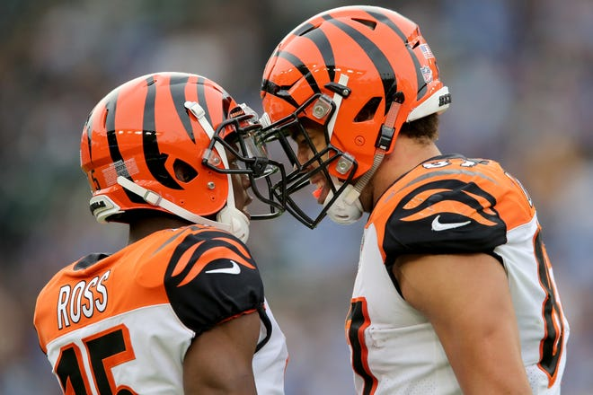 Cincinnati Bengals wide receiver John Ross (15) and Cincinnati Bengals tight end C.J. Uzomah (87) embrace after Uzomah completed a catch in the third quarter of a Week 14 NFL football game against the Los Angeles Chargers, Sunday, Dec. 9, 2018, at StubHub Center in Carson, California.