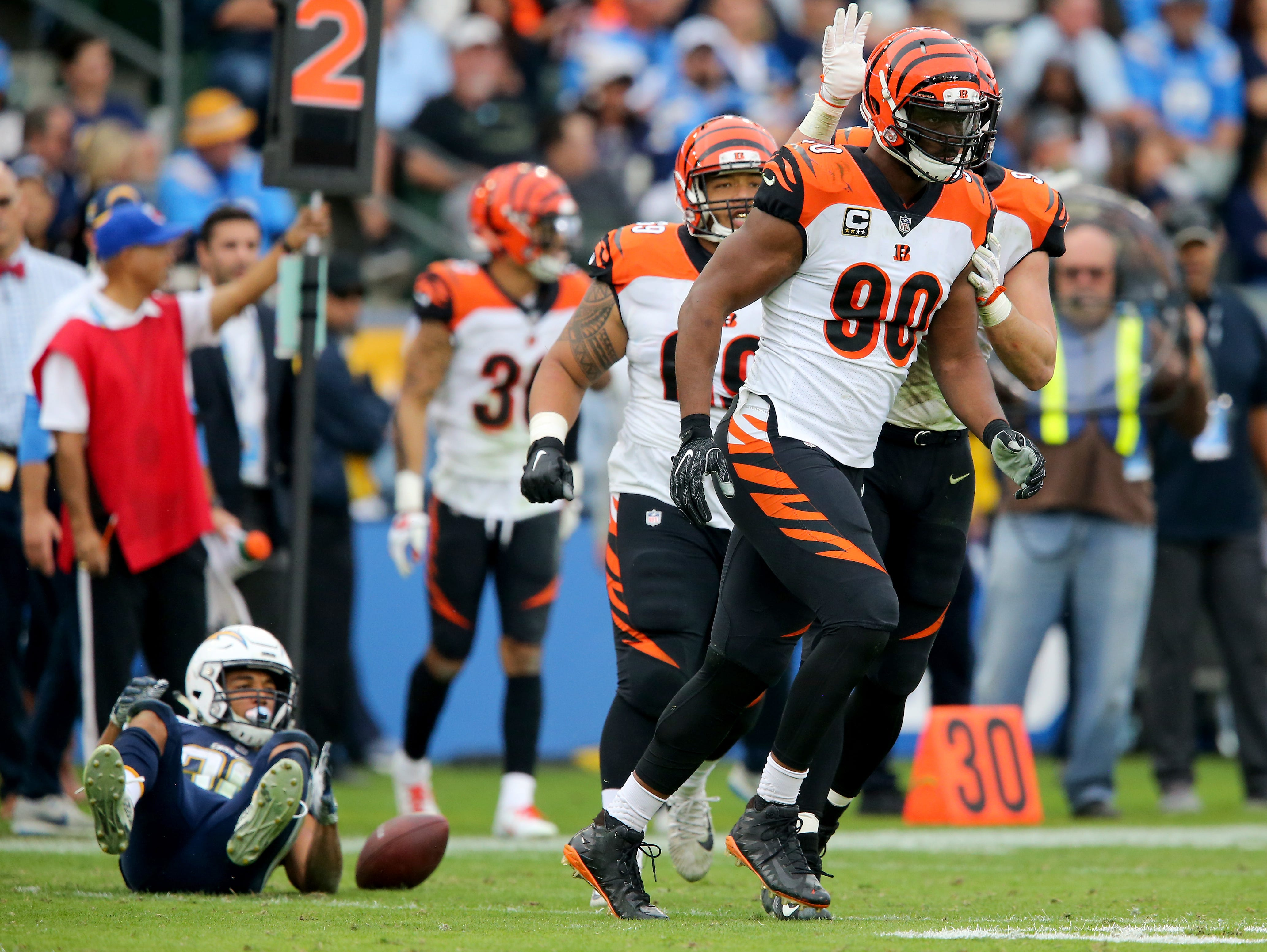 Cincinnati Bengals defensive end Michael Johnson (90) jogs back to the huddle after tackling Los Angeles Chargers running back Austin Ekeler (30), far left, for a loss in the fourth quarter of a Week 14 NFL football game, Sunday, Dec. 9, 2018, at StubHub Center in Carson, California. The Los Angeles Chargers won 26.21.