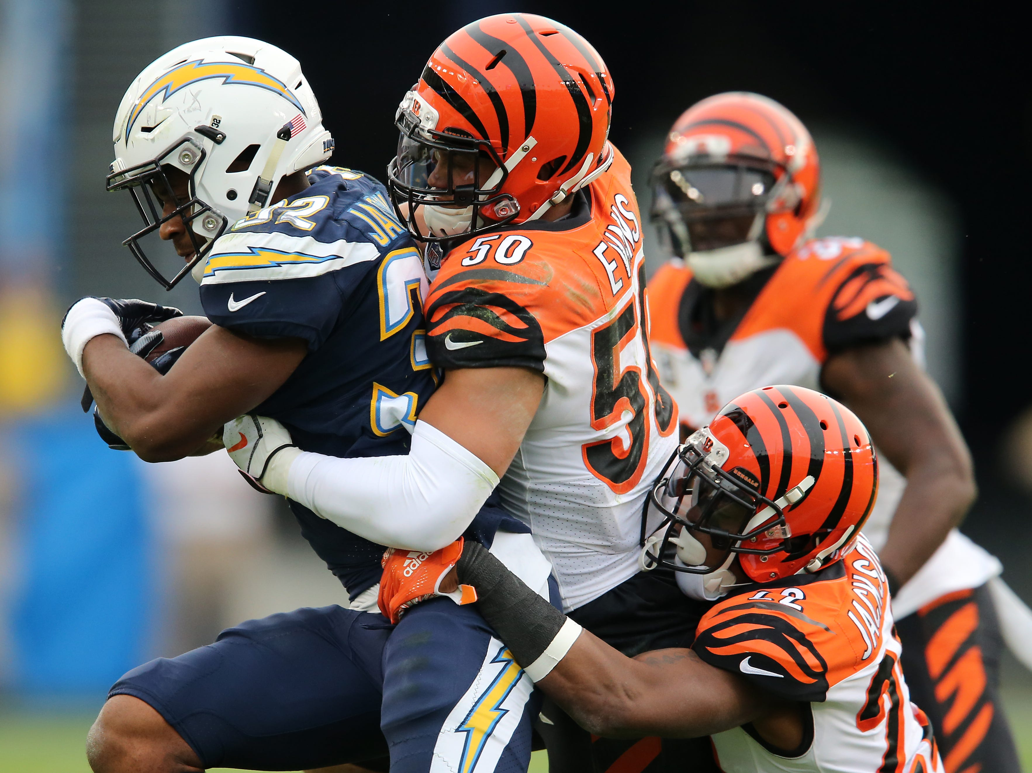 Los Angeles Chargers wide receiver Mike Williams (81) completes a catch as Cincinnati Bengals cornerback William Jackson (22) defends in the third quarter of a Week 14 NFL football game, Sunday, Dec. 9, 2018, at StubHub Center in Carson, California.