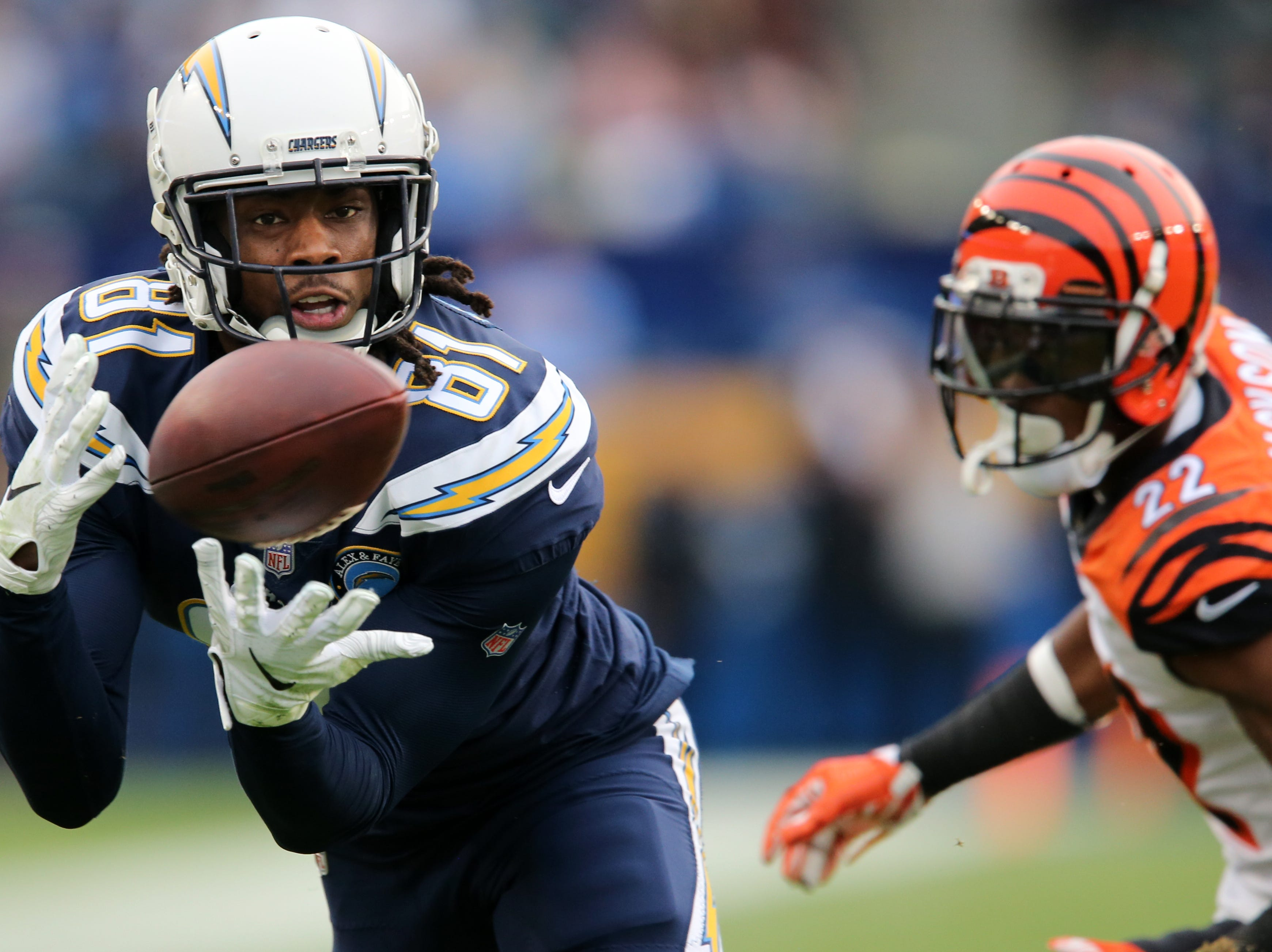 Los Angeles Chargers wide receiver Mike Williams (81) completes a catch as Cincinnati Bengals cornerback William Jackson (22) defends in the XX quarter of a Week 14 NFL football game against the Los Angeles Chargers, Sunday, Dec. 9, 2018, at StubHub Center in Carson, California.
