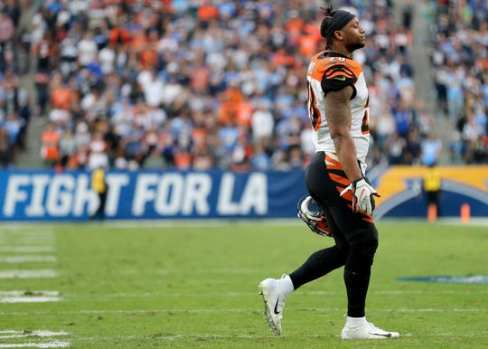 Cincinnati Bengals running back Joe Mixon (28) walks off the field after the team failed to convert a game-tying two-point conversion in the fourth quarter of a Week 14 NFL football game against the Los Angeles Chargers, Sunday, Dec. 9, 2018, at StubHub Center in Carson, California. The Los Angeles Chargers won 26.21.