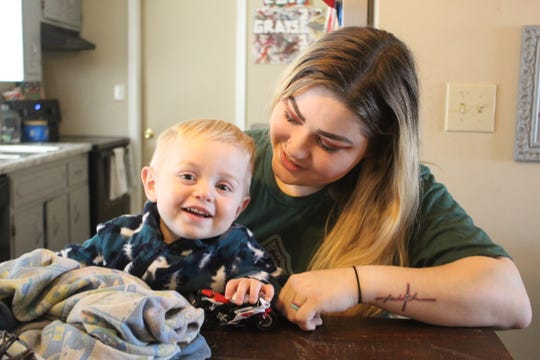 Jessica Phillips and her 2-year old son Wyatt, after learning their Christmas toys on layaway at Wal-Mart had been paid off by a local couple.