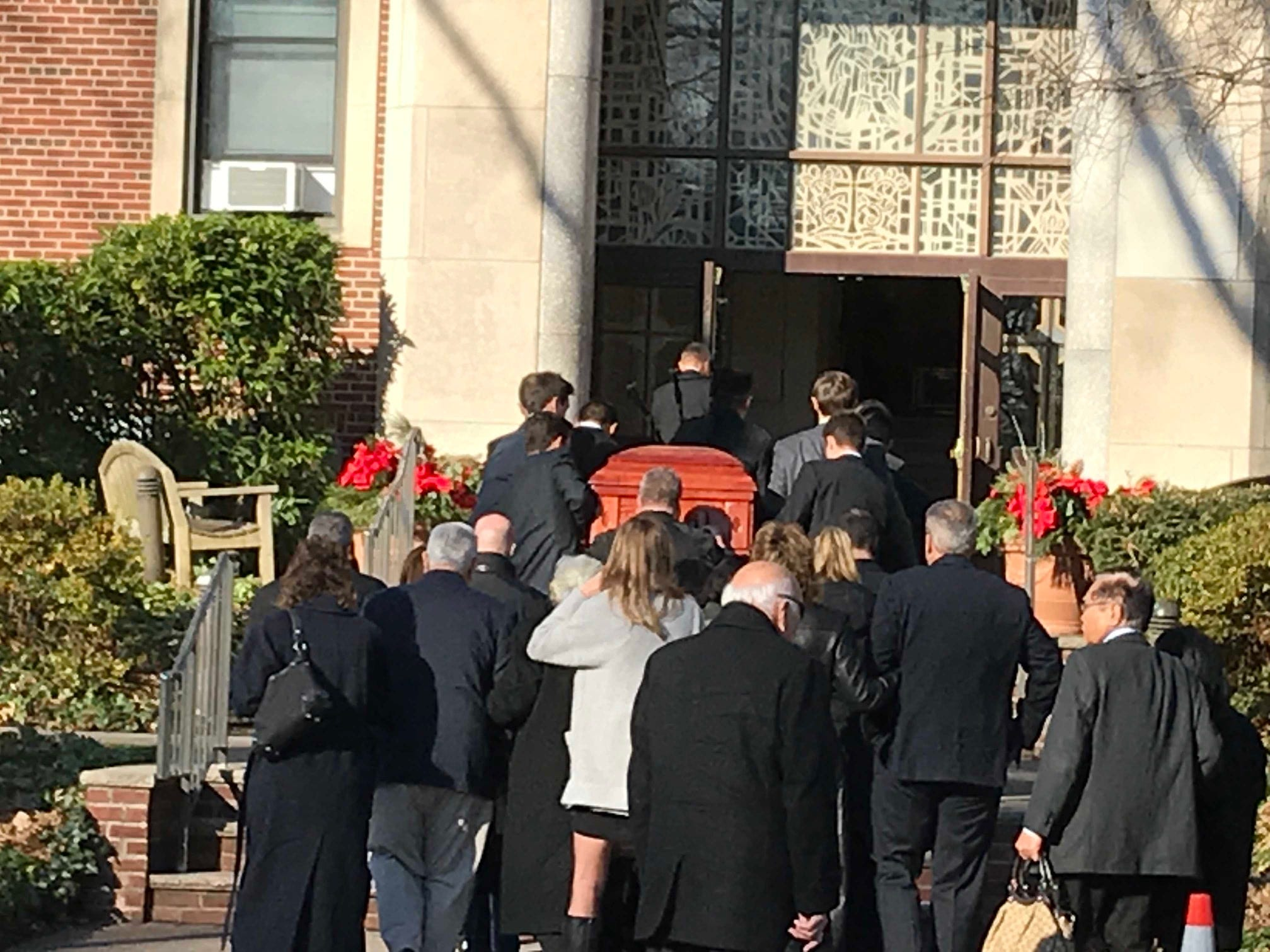 Michael Sot's casket is carried into St. John the Apostle RC Church in Linden for his funeral.