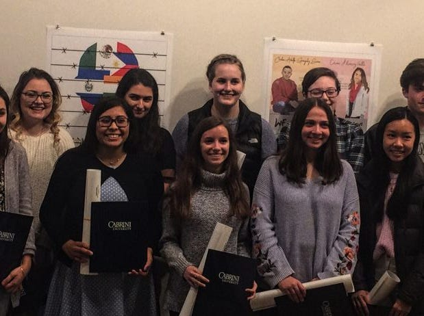 Cabrini University faculty members Jeanne Komp (back left) and Don Dempsey (back right) congratulate the 2018 Art + Effect poster winners. Four of the seven winners from Polytech attended the Nov.18 exhibition, and they include Sophia Brotons and Angeles Garcia in the front, left, and Alyssa Morris and Nicole Bayne in the back, left.