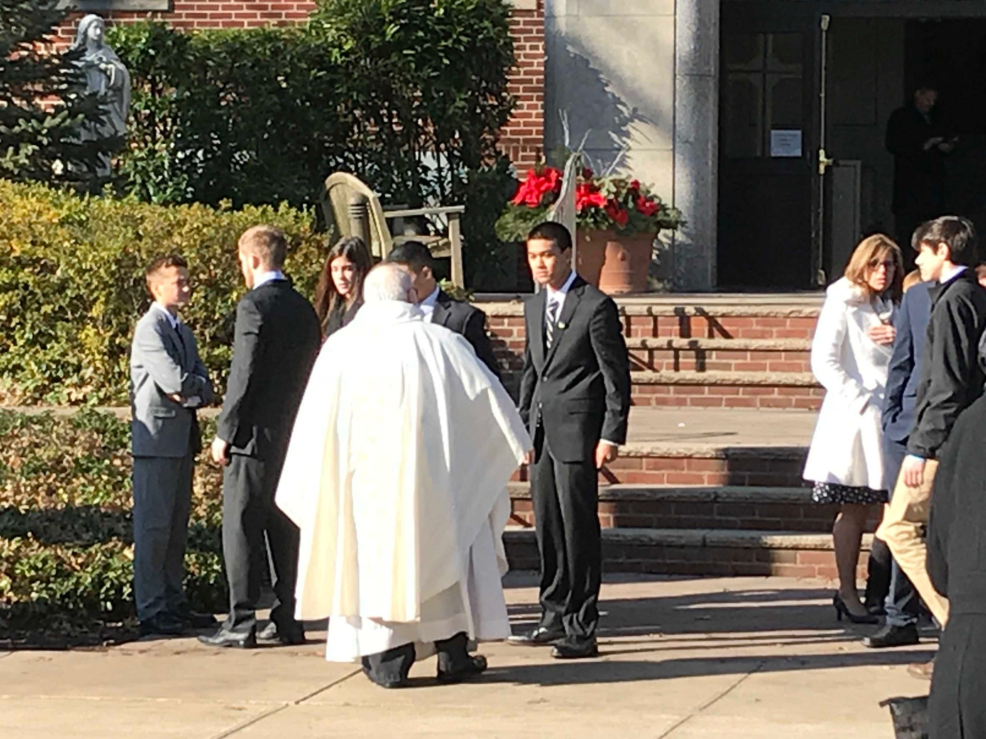 Mourners outside the church following the funeral for Michael Sot, 20, of Clark.