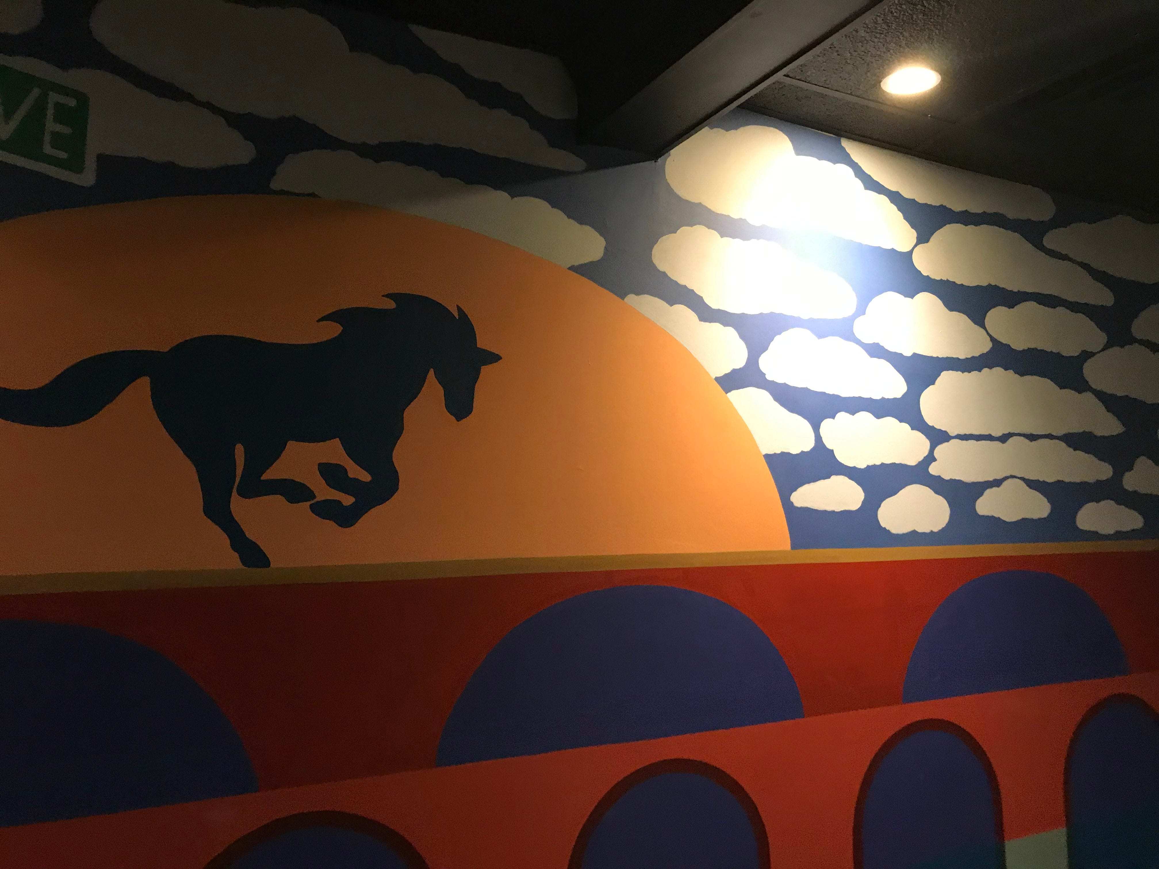 The Gallery Lounge of The Blue Horse in Highland Park features a mural by a local artist.
