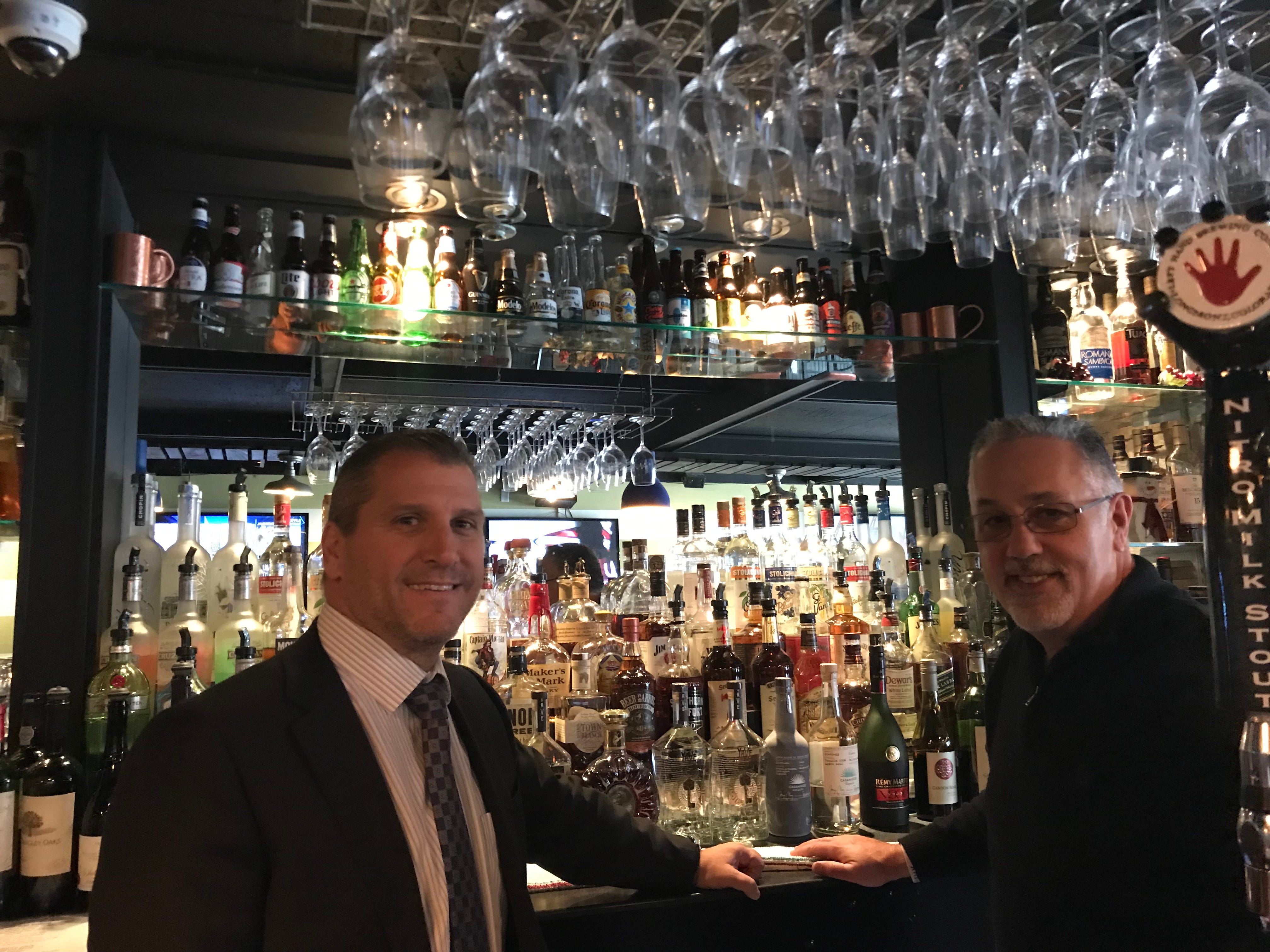 The Blue Horse co-owner/operations director Joe Amore and  General Manager are pictured at the new Highland Park restaurant's bar.