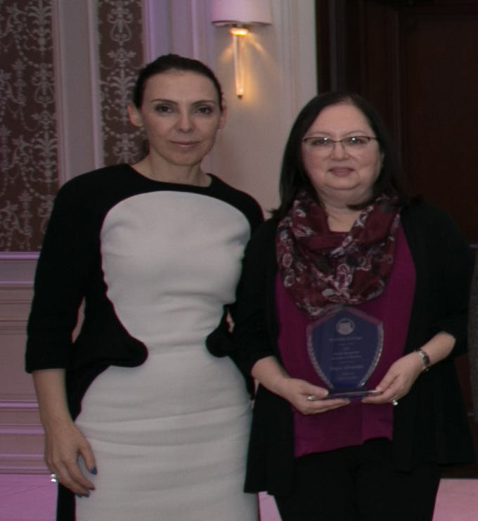 """Professor Doris Alvarado, MD, Berkeley College School of Health Sciences (above right), receives the Excellence in Teaching Award during the 2018 Berkeley College Faculty Recognition Awards dinner, held on November 14, 2018, at The Terrace in Paramus, NJ.  She is pictured with Eva Skuka, MD, Dean, Berkeley College School of Health Studies.""""I think a great teacher connects with every student that enters his or her classroom,"""" said Dr. Alvarado.""""On the first day of class, I engage with the students individually to learn more about who they are, why they have chosen a career in the medical field and what their expectations are for my class.  Knowing my students well provides me the information needed to establish an optimal learning environment for each one of them, ensuring they leave each day with new knowledge and a desire to return for more."""" Dr. Alvarado is a resident of Scotch Plains."""