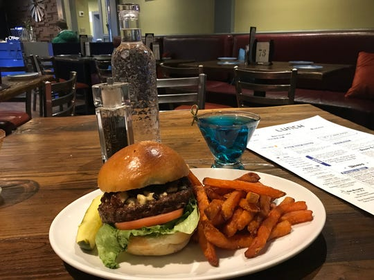 Highland Park-based The Blue Horse's signature cocktail, the Blue Horse, is paired with its signature Blue Horse Burger.