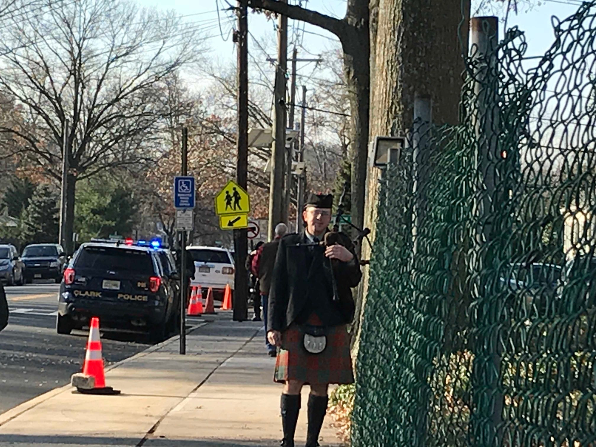 "This bagpipe player performed ""Amazing Grace"" in the church during the funeral for Michael Sot, 20, of Clark who died after his car was struck head-on Dec. 2."