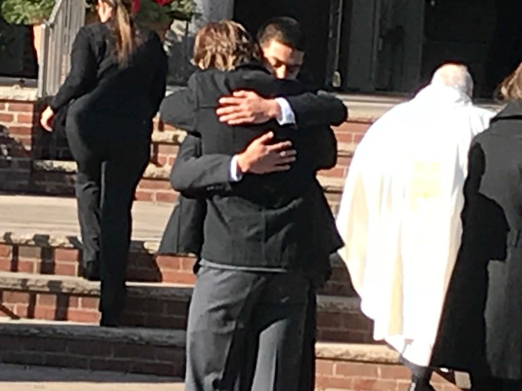 John Sot hugs a mourner at the funeral for his brother, Michael, a student at the College of New Jersey