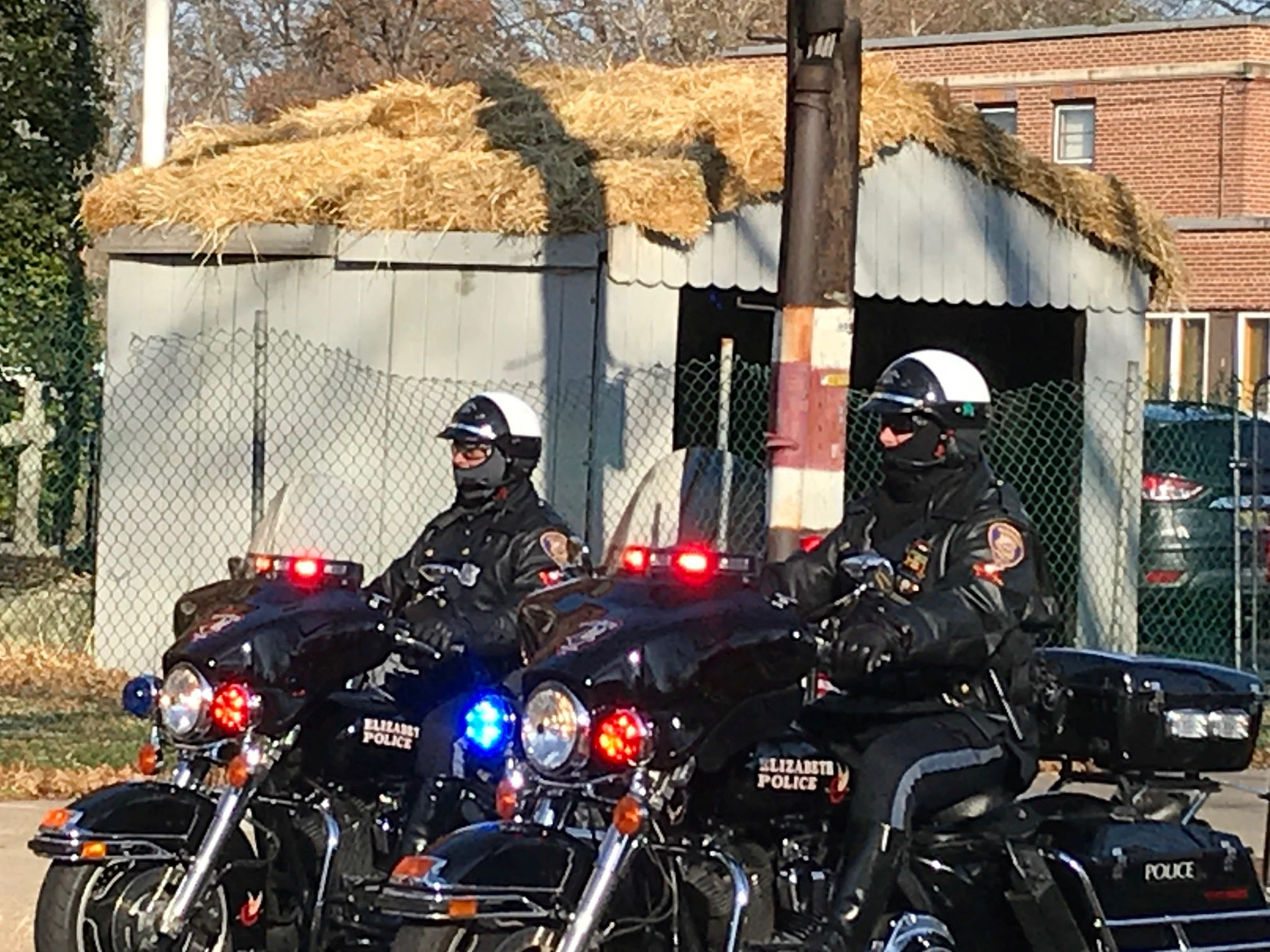 Motorcycle police led the procession to the church for Michael Sot's funeral Monday.