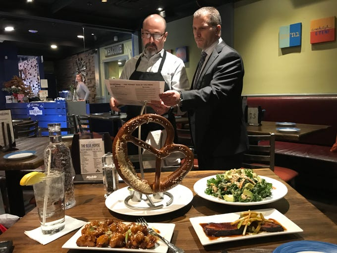 CAM Hospitality Group co-owners Executive Chef Jeff McNamara and Operations Director Joe Amore look over the menu at their new Blue Horse restaurant in Hgihland Park. They also own Pines Manor and Skylark Diner, both Edison, with partner and CFO Dan Caputo.