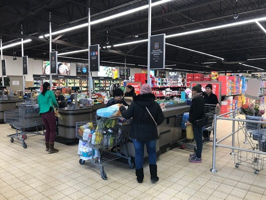 Customers Checking Out