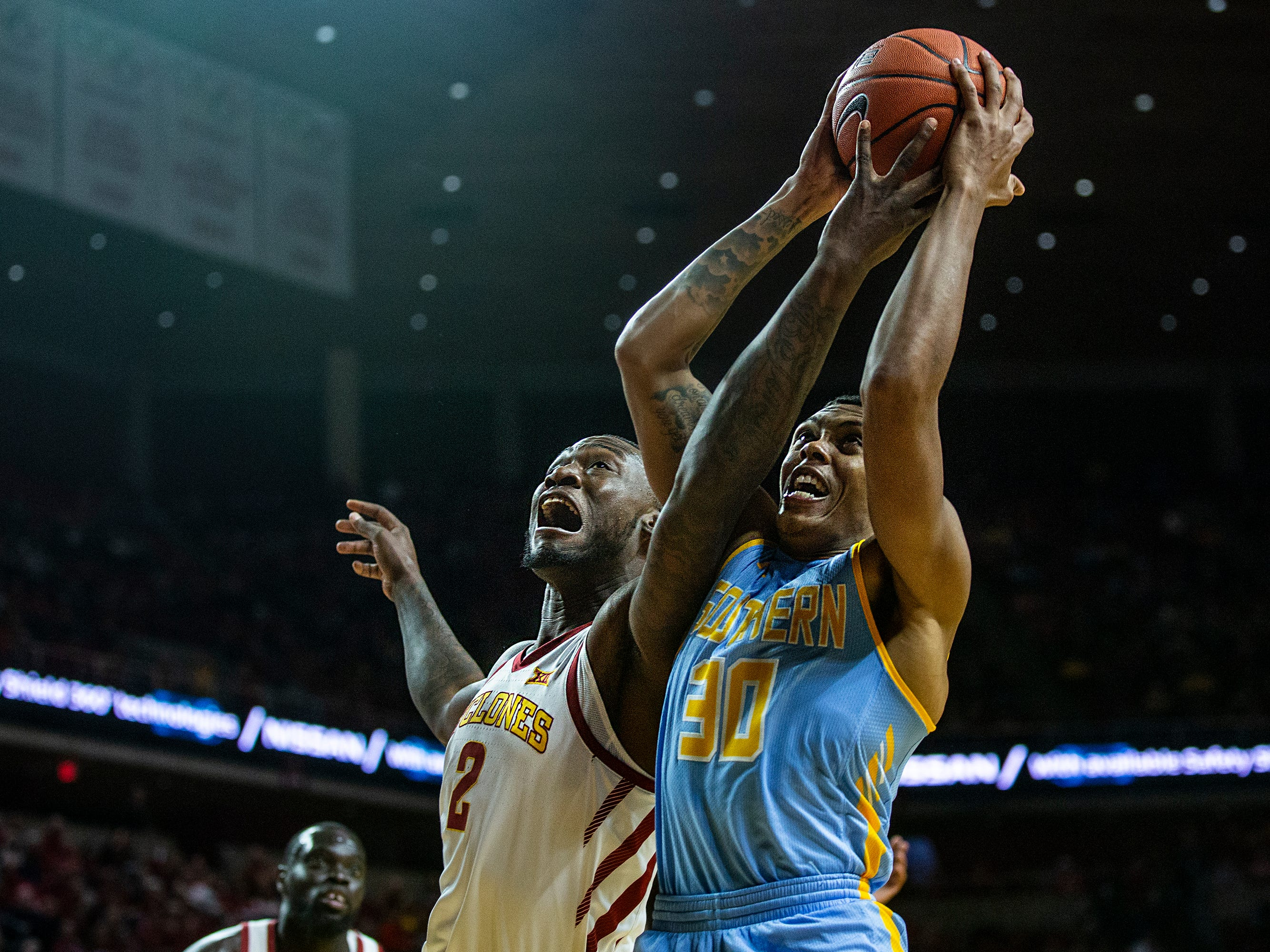 Iowa State's Cameron Lard and Southern's DeRias Johnson reach for a rebound during the Iowa State men's basketball game against Southern on Sunday, Dec. 9, 2018, in Hilton Coliseum.