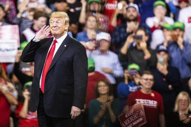 President Donald Trump enters the Mid-America Center to a standing-room-only crowd during a rally on Tuesday, Oct. 9, 2018, in Council Bluffs.