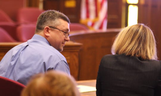 Jason Carter, left, speaks with his lawyer, Christine Branstad at a hearing at the Marion County Courthouse on Monday, Dec. 10, 2018 arguing that a $10 million civil judgment against him in his mother's shooting death should be overturned.