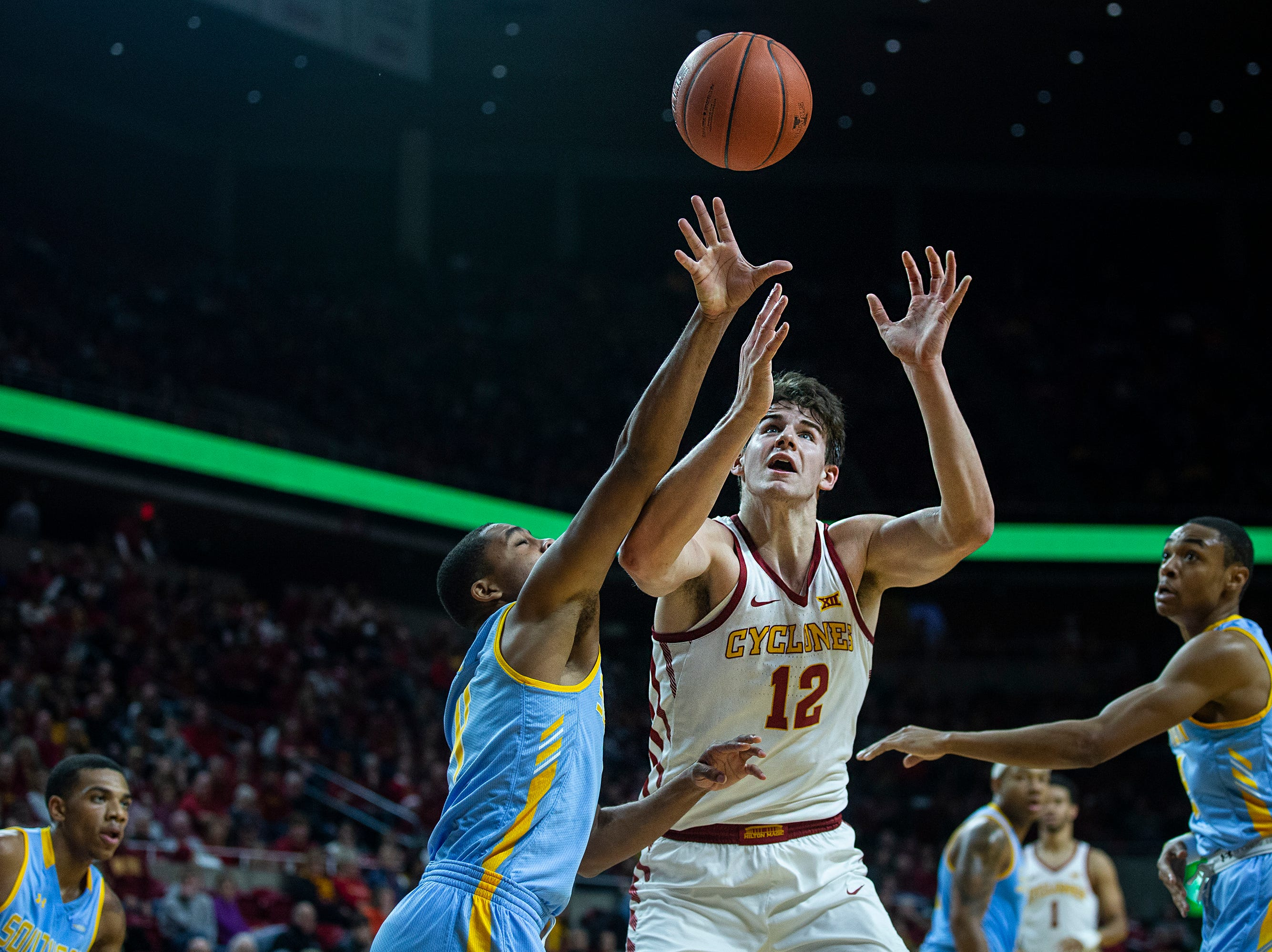 Iowa State's Michael Jacobson reaches for the ball during the Iowa State men's basketball game against Southern on Sunday, Dec. 9, 2018, in Hilton Coliseum.
