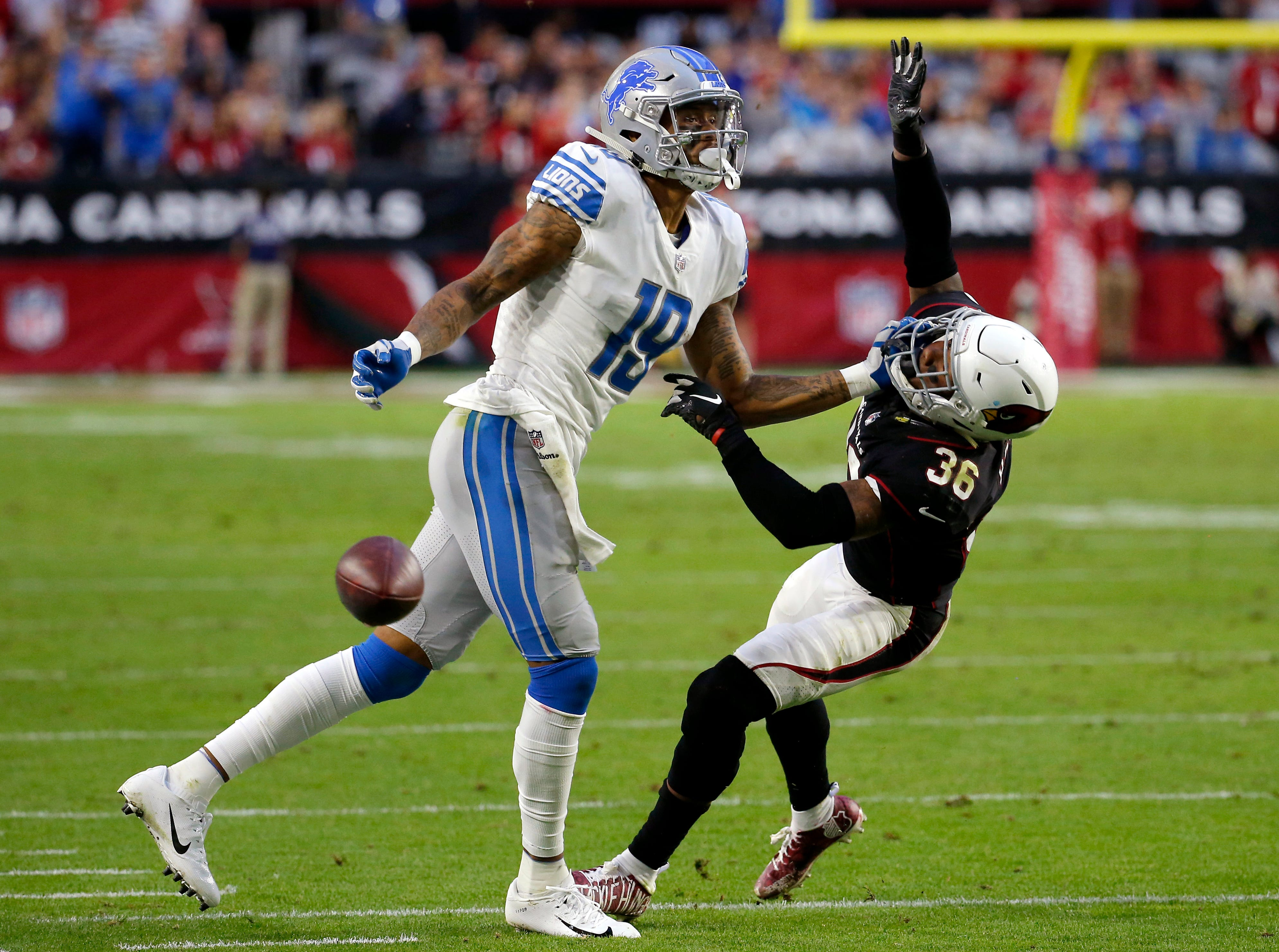 Arizona Cardinals strong safety Budda Baker (36) draws a penalty against Detroit Lions wide receiver Kenny Golladay (19) during the second half.