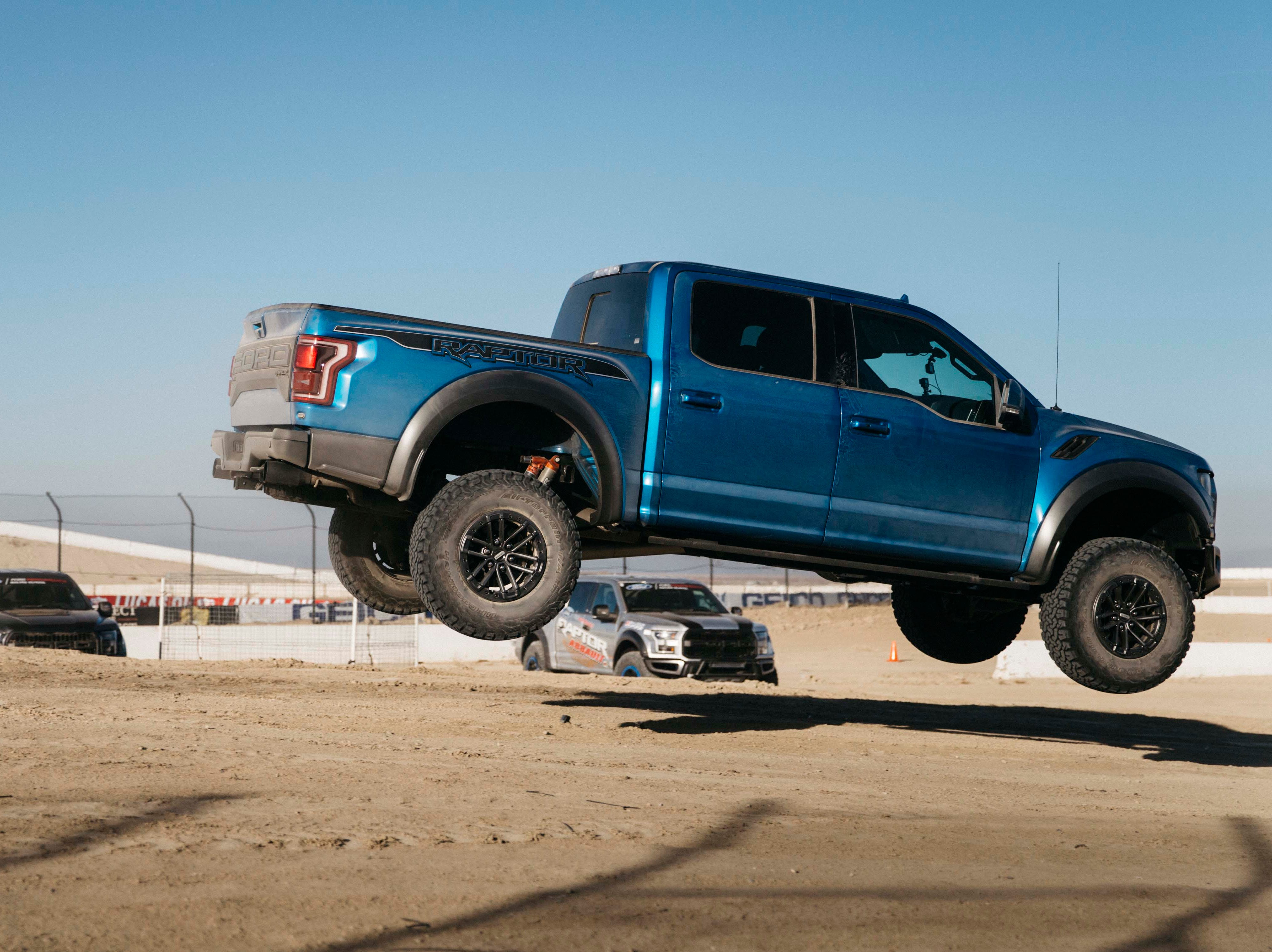 Wild child. The 5,500-pound, 2019 Ford F-150 Raptor negotiates a jump at 60 mph, landing without drama thanks to its robust chassis engineering and Fox Live Valve shocks.