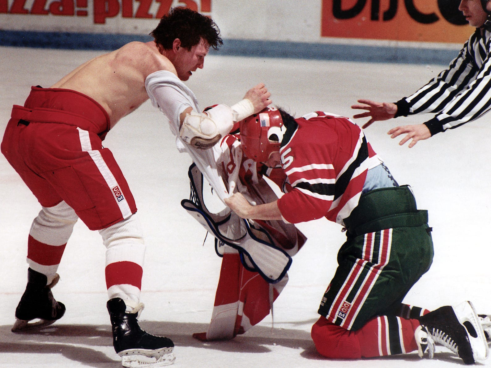 1991: The playoff streak started in an inauspicious manner. The Red Wings had modest success during the regular season, which was memorable chiefly for a titanic fight between the Red Wings' Bob Probert, left, and the New Jersey Devils' Troy Crowder. The Wings finished third in the Norris Division under coach Bryan Murray.