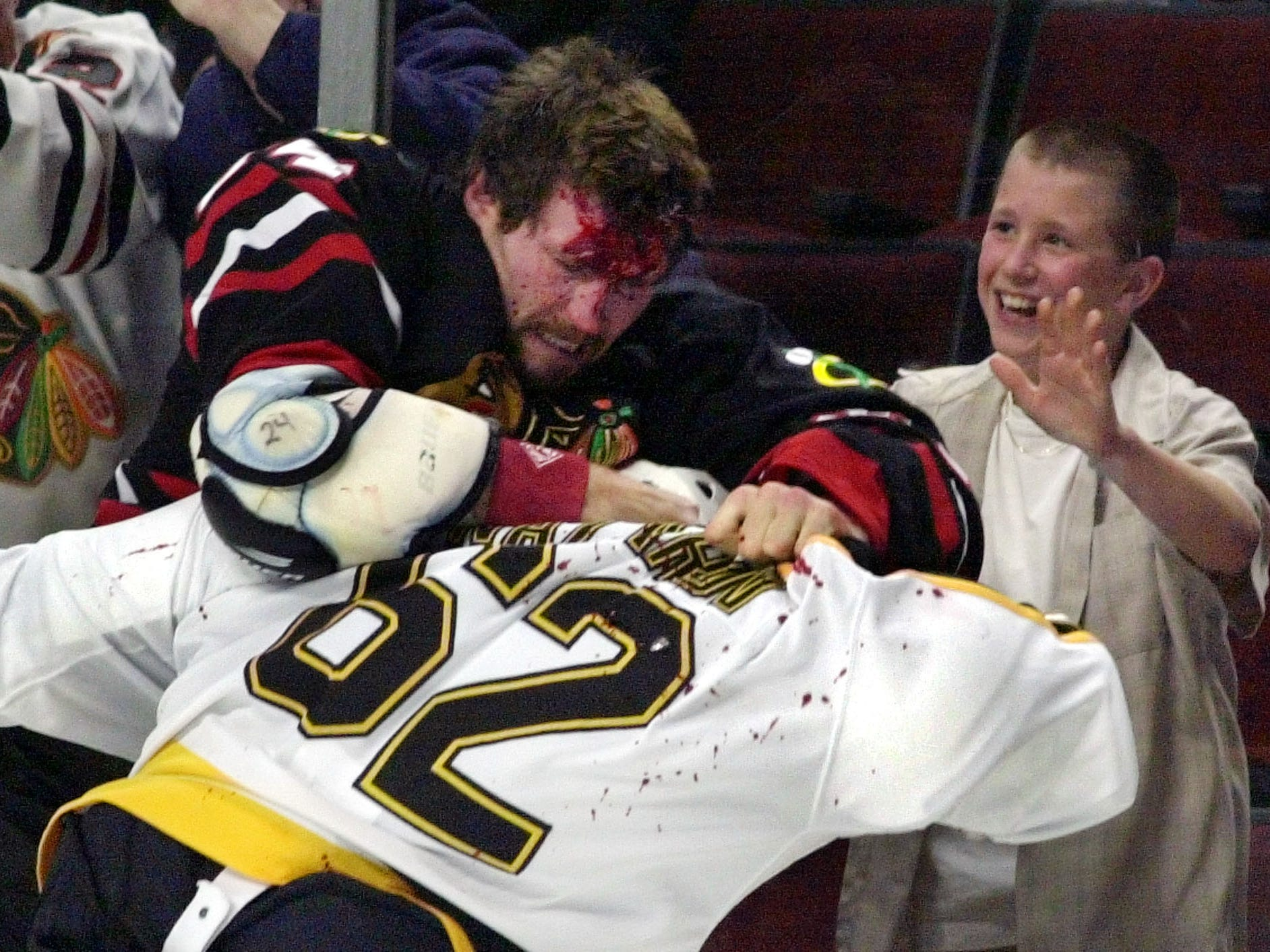 FILE - In this Oct. 28, 2001 file photo, Chicago Blackhawks' Bob Probert, left, and Boston Bruins' Andrei Nazarov mix it up along the boards during a first period fight in Chicago. Enforcers, goons, whatever you want to call them, players like Bob Probert and Derek Boogaard made careers from dishing out and taking punishing hits. That job is sure to come under added scrutiny after the sudden death of Boogaard, five months after he suffered a season-ending concussion.