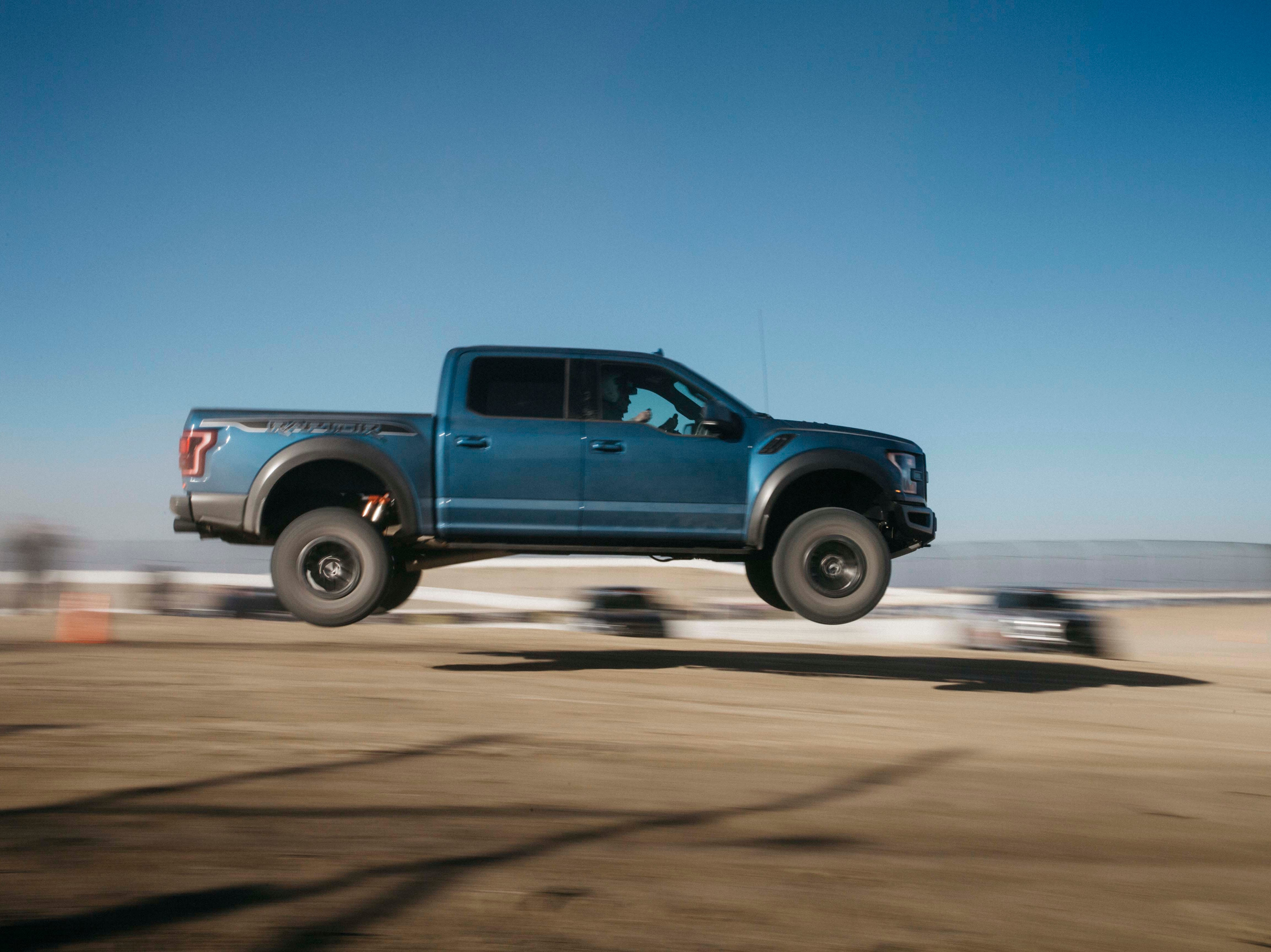 The 5,500-pound, 2019 Ford F-150 Raptor negotiates a jump at 60 mph —  landing without drama thanks to its robust chassis engineering and Fox Live Valve shocks.