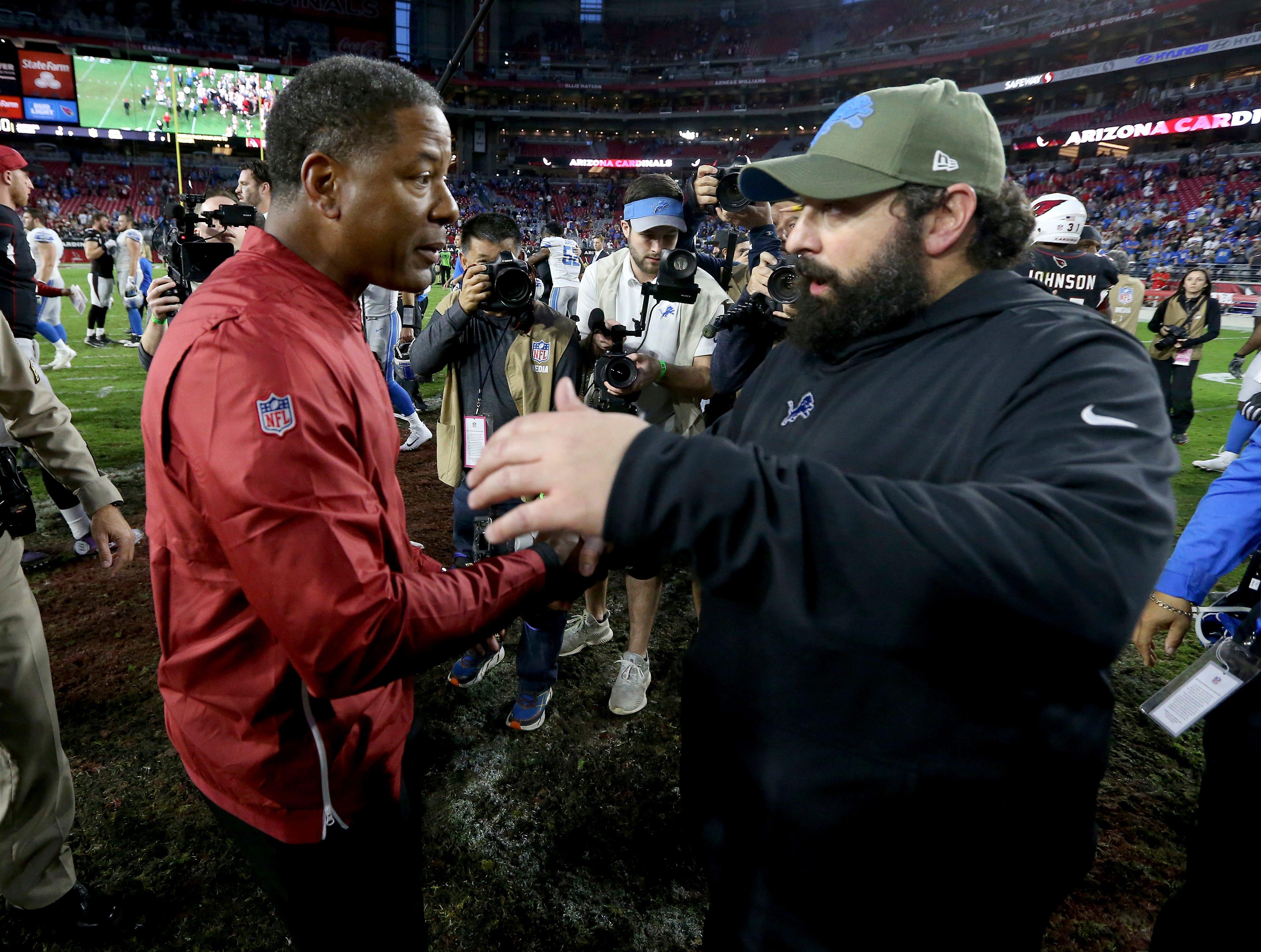 Arizona Cardinals head coach Steve Wilks. left, greets Detroit Lions head coach Matt Patricia after the game.