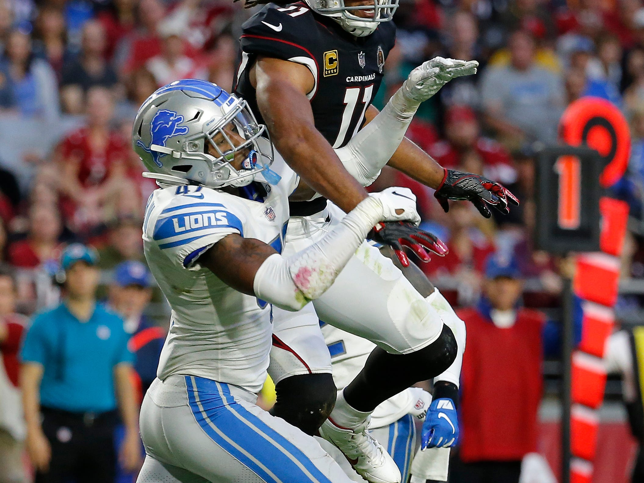 Arizona Cardinals wide receiver Larry Fitzgerald (11) can't make a catch as Detroit Lions defensive back Tracy Walker defends during the second half.