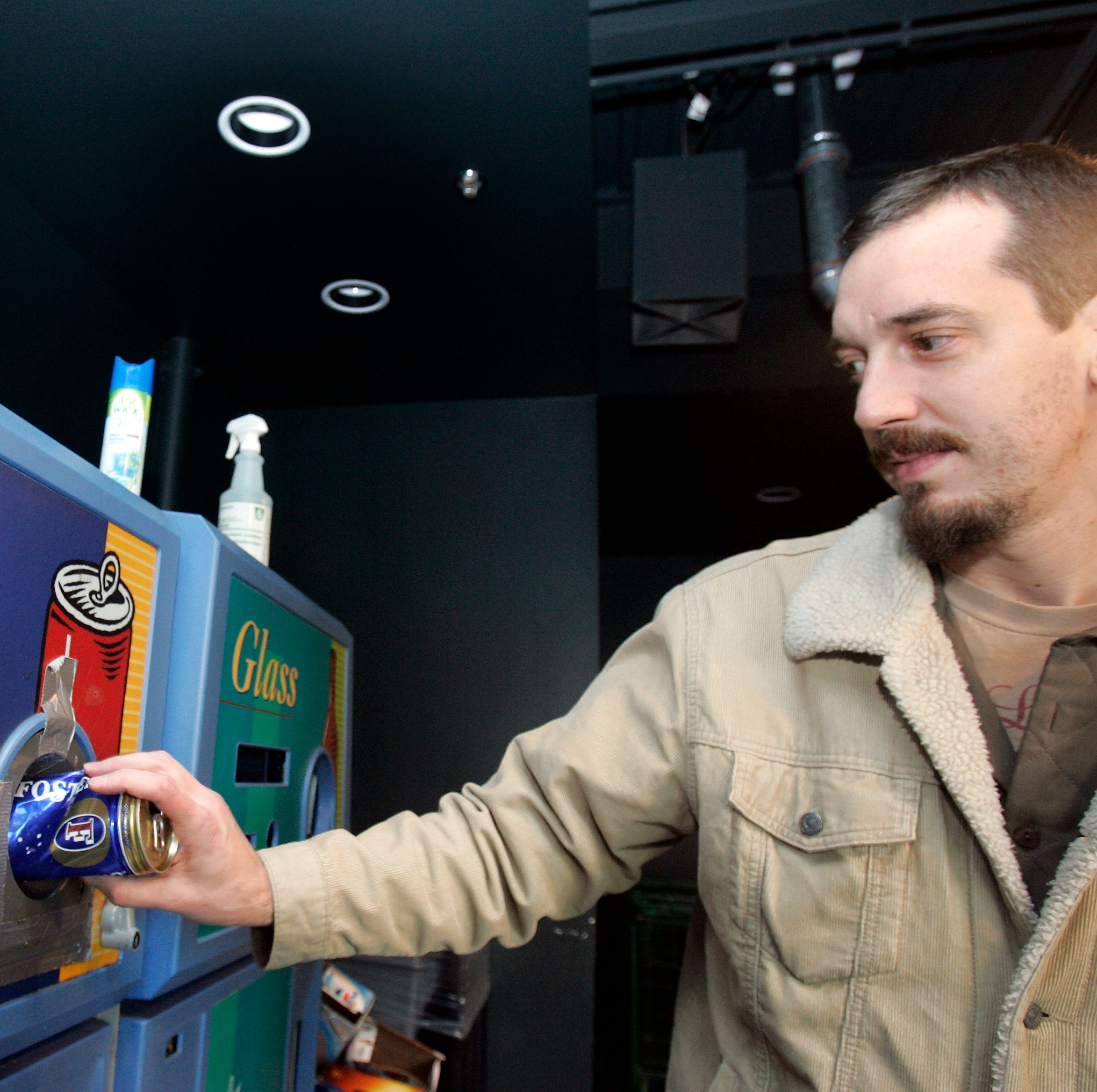 FILE -- Alex Goecke, of Royal Oak, returns beer cans and bottles before shopping at Holiday Market in Royal Oak.