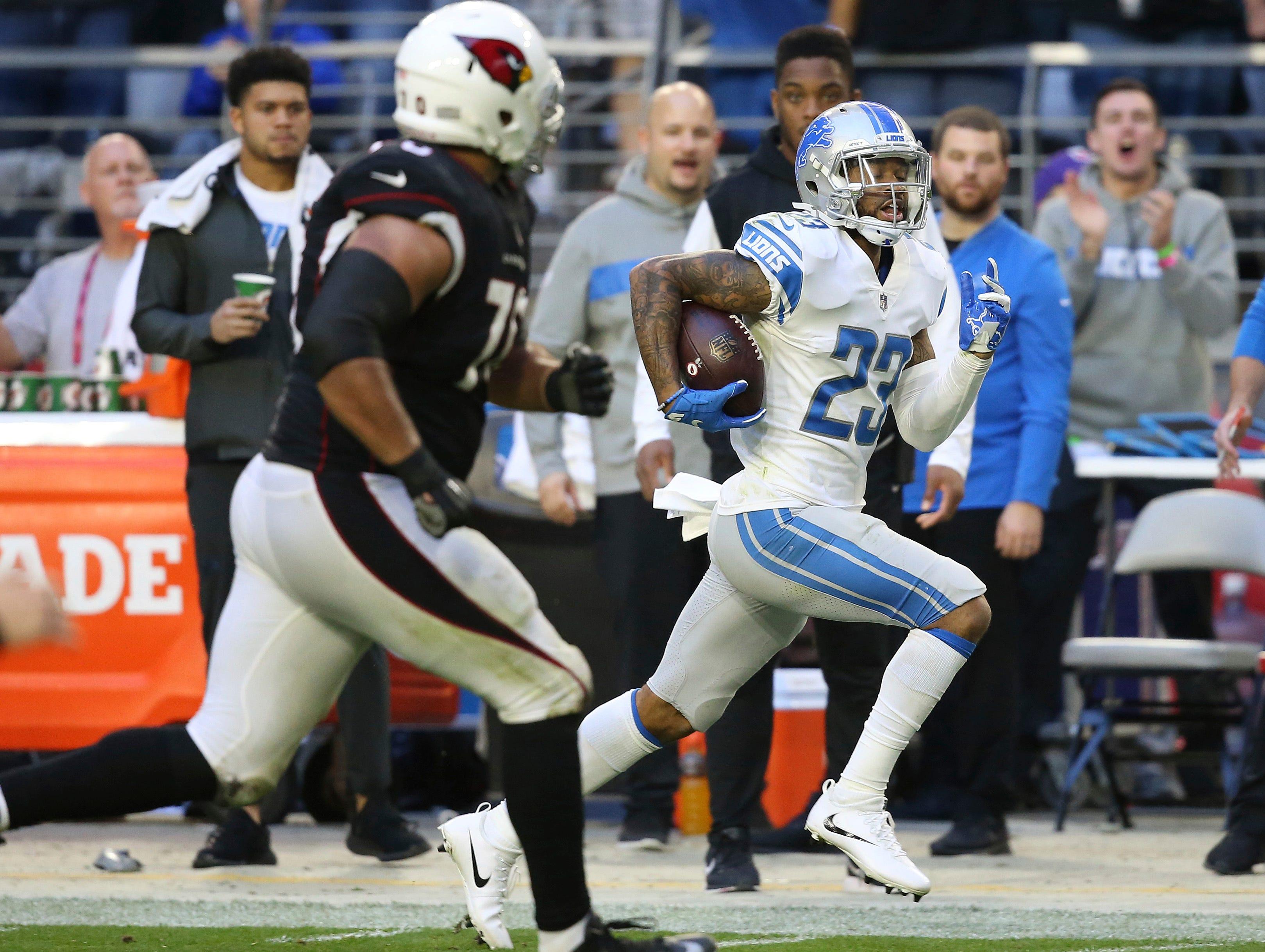 Detroit Lions cornerback Darius Slay (23) runs back an interception for a touchdown agsint the Arizona Cardinals during the second half.
