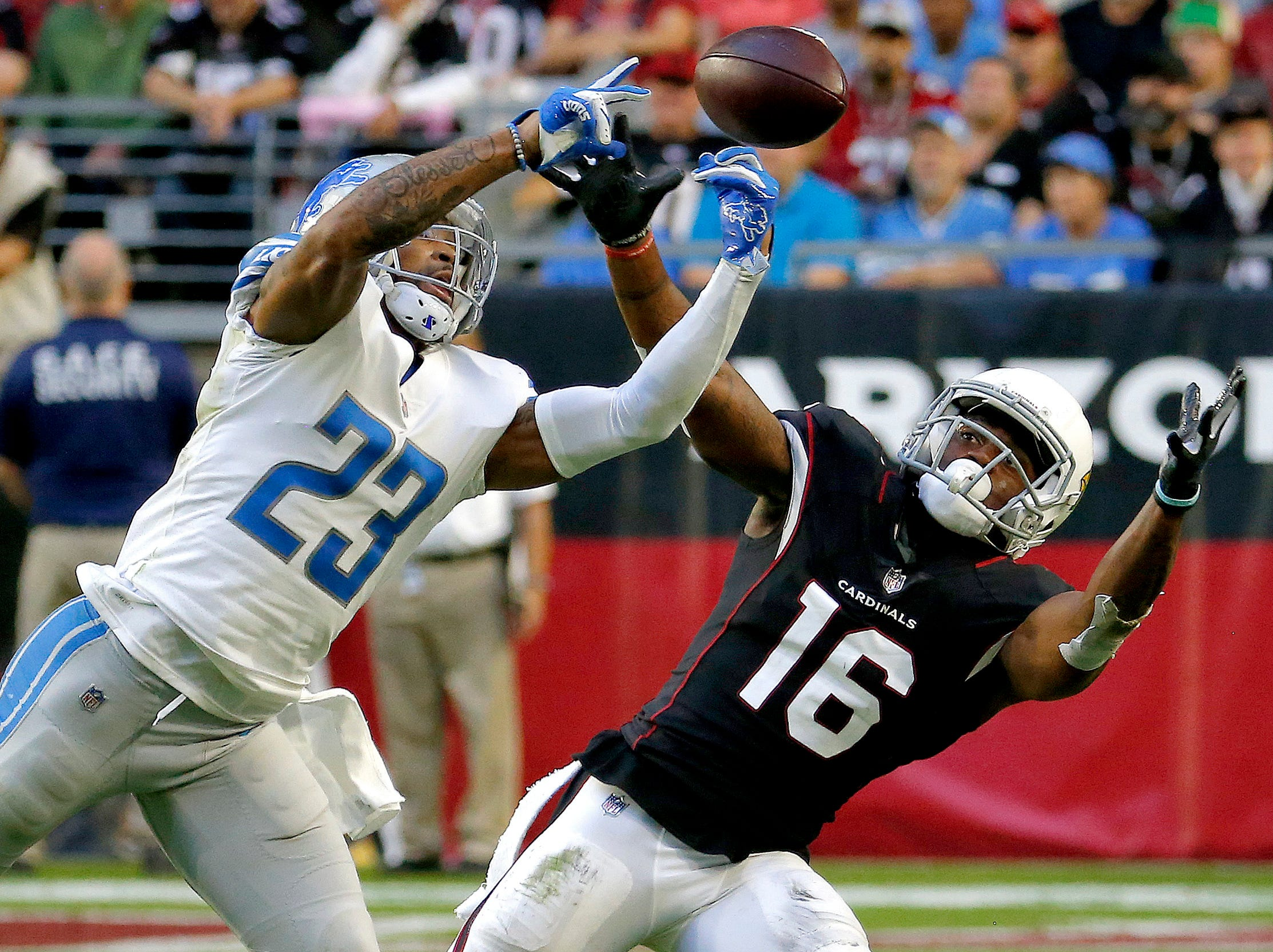 Detroit Lions cornerback Darius Slay (23) intercepts a pass intended for Arizona Cardinals wide receiver Trent Sherfield (16) during the second half.