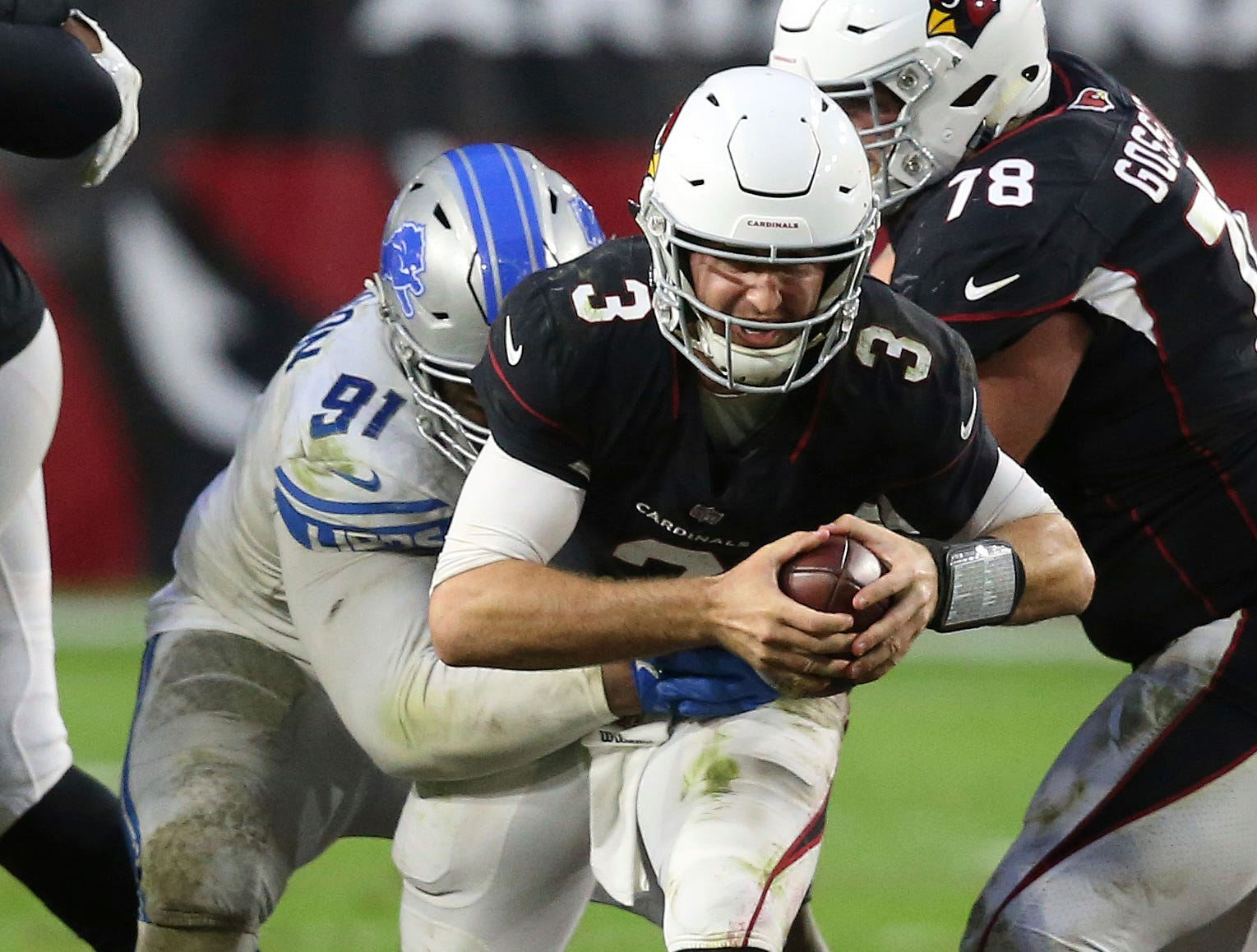 Arizona Cardinals quarterback Josh Rosen (3) is sacked by Detroit Lions defensive tackle A'Shawn Robinson (91) during the second half.
