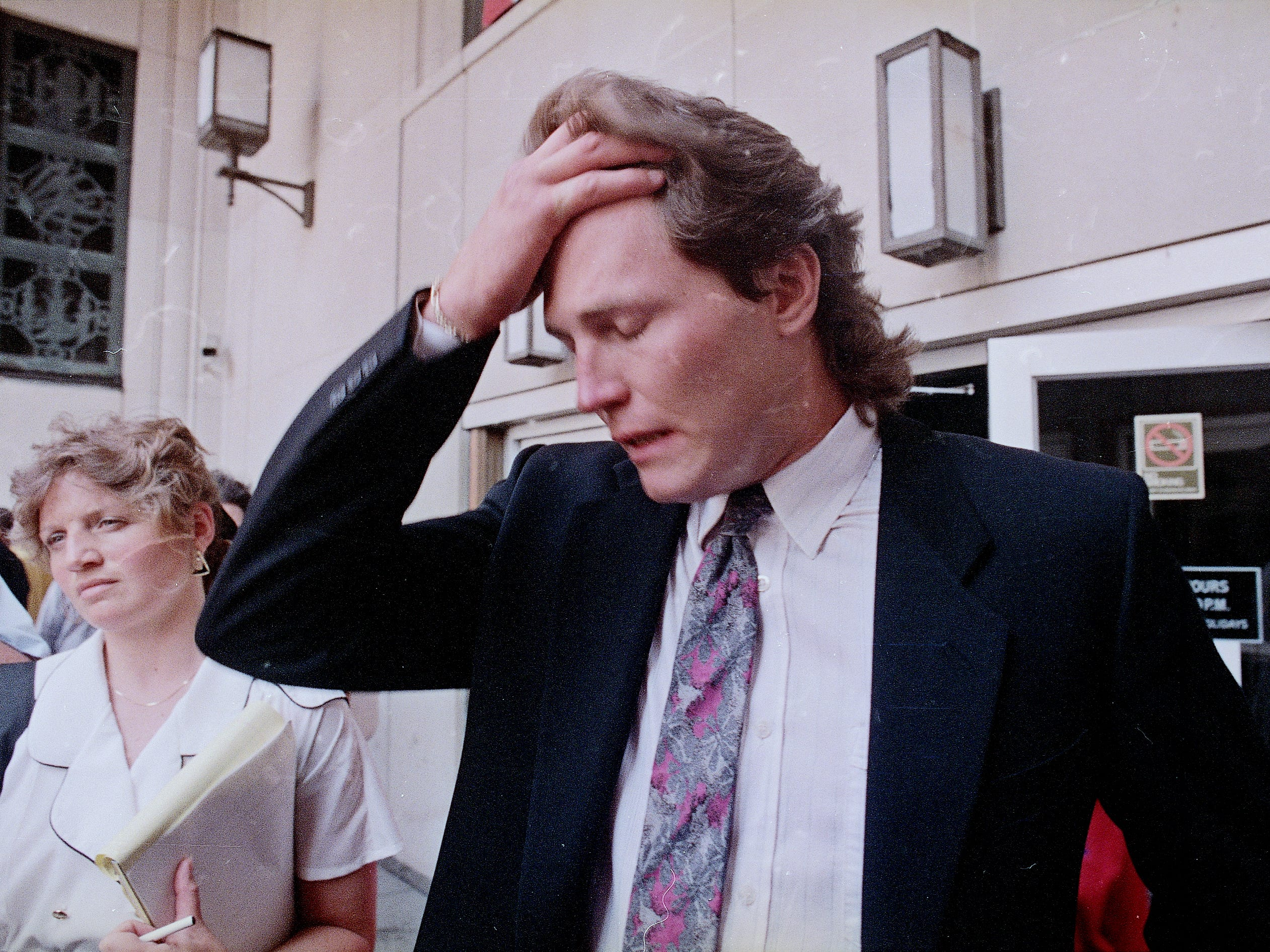 Bob Probert talks to reporters on the steps of federal courthouse in Detroit after pleading guilty to cocaine possession on July 18, 1989.