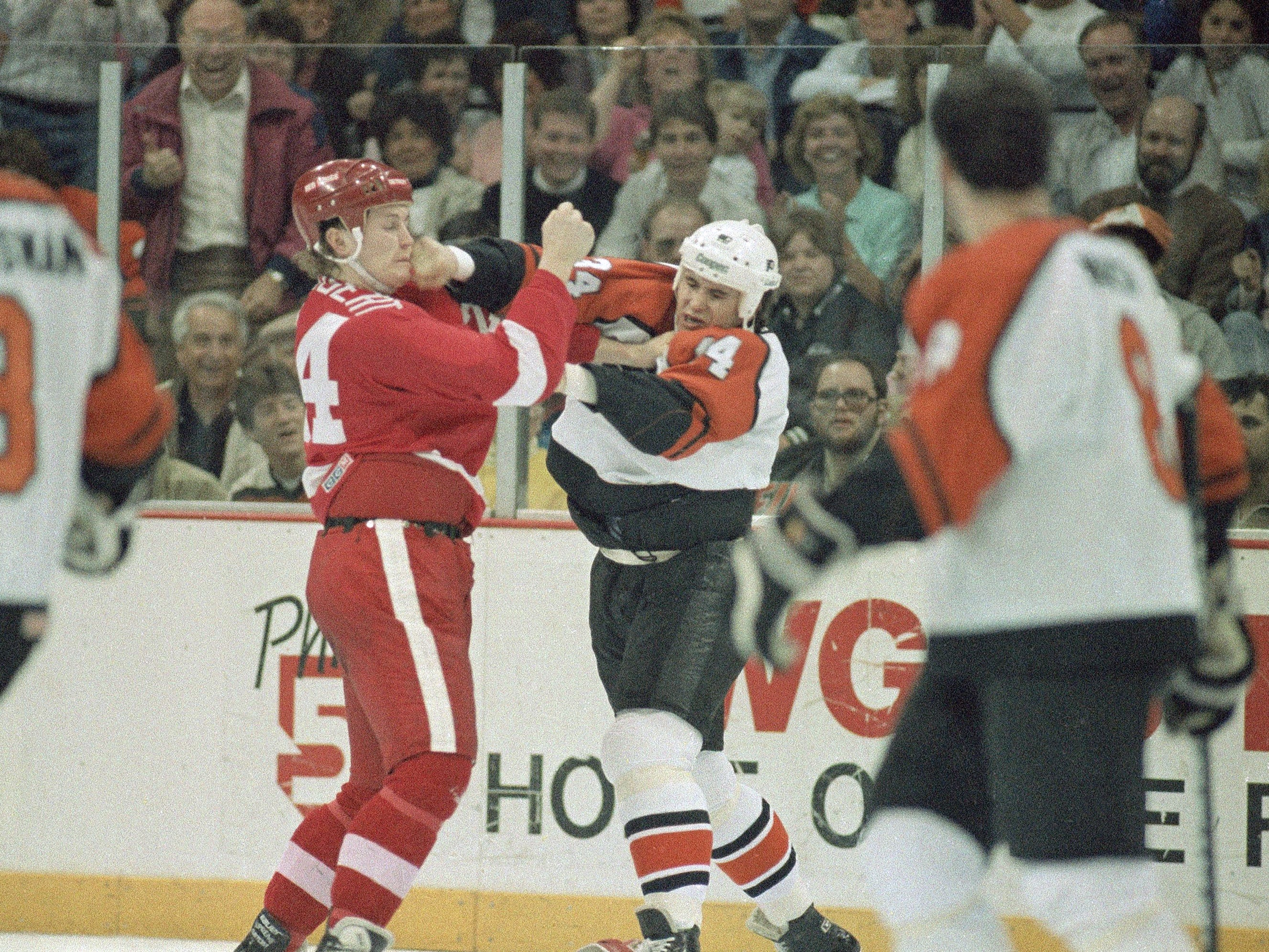 Philadelphia Flyers left wing Craig Berube, right, follows through with a right hand to Detroit Red Wings left wing Bob Probert's face during a fight in the first period of 1987 game at the Spectrum in Philadelphia.