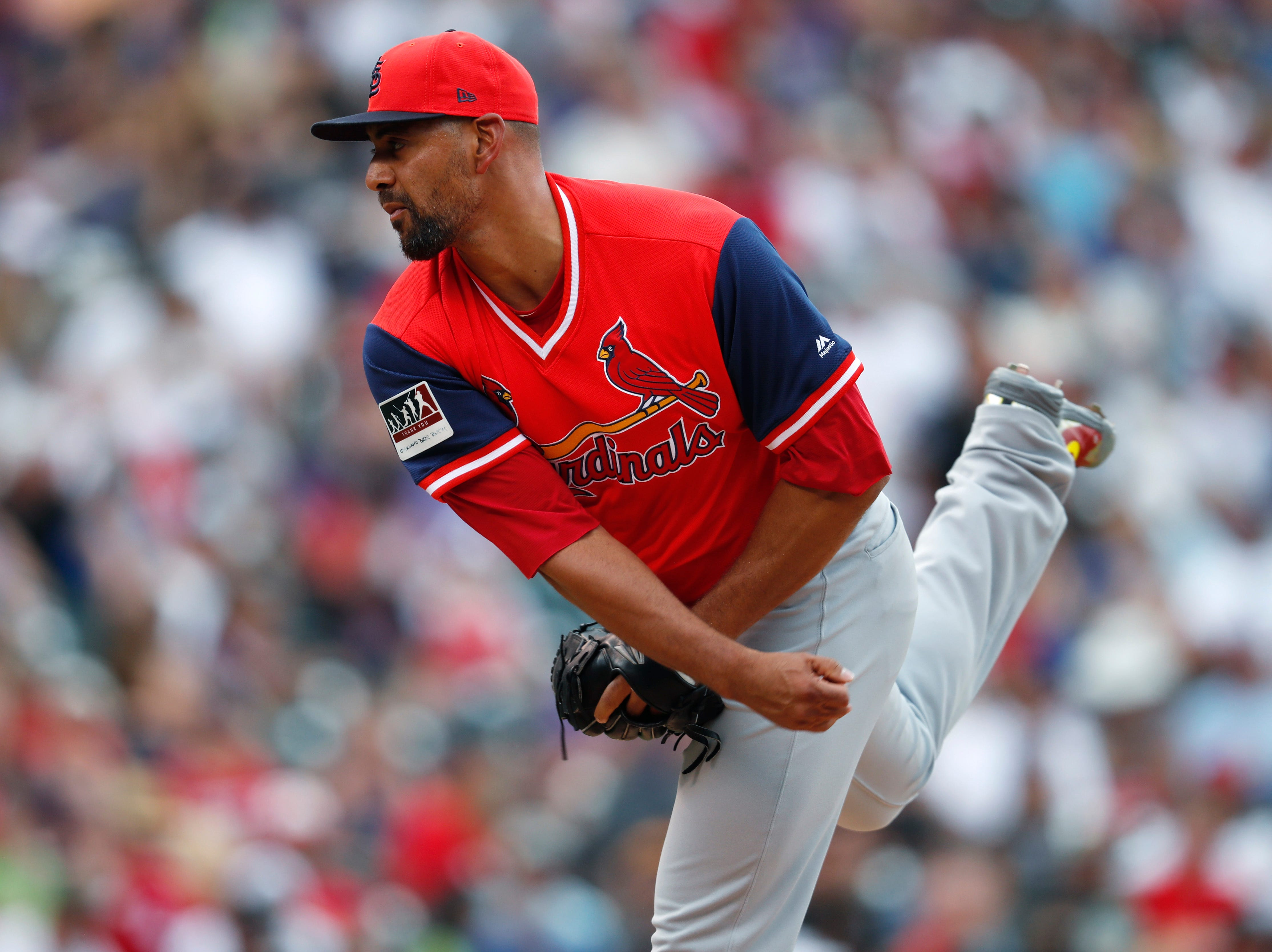 St. Louis Cardinals starting pitcher Tyson Ross works against the Colorado Rockies in the seventh inning of a game Sunday, Aug. 26, 2018, in Denver.