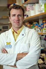 Peter Todd, a UM associate professor of neurology and one of three clinicians and co-director of the Fragile X Syndrome Clinic at the UM Health System.