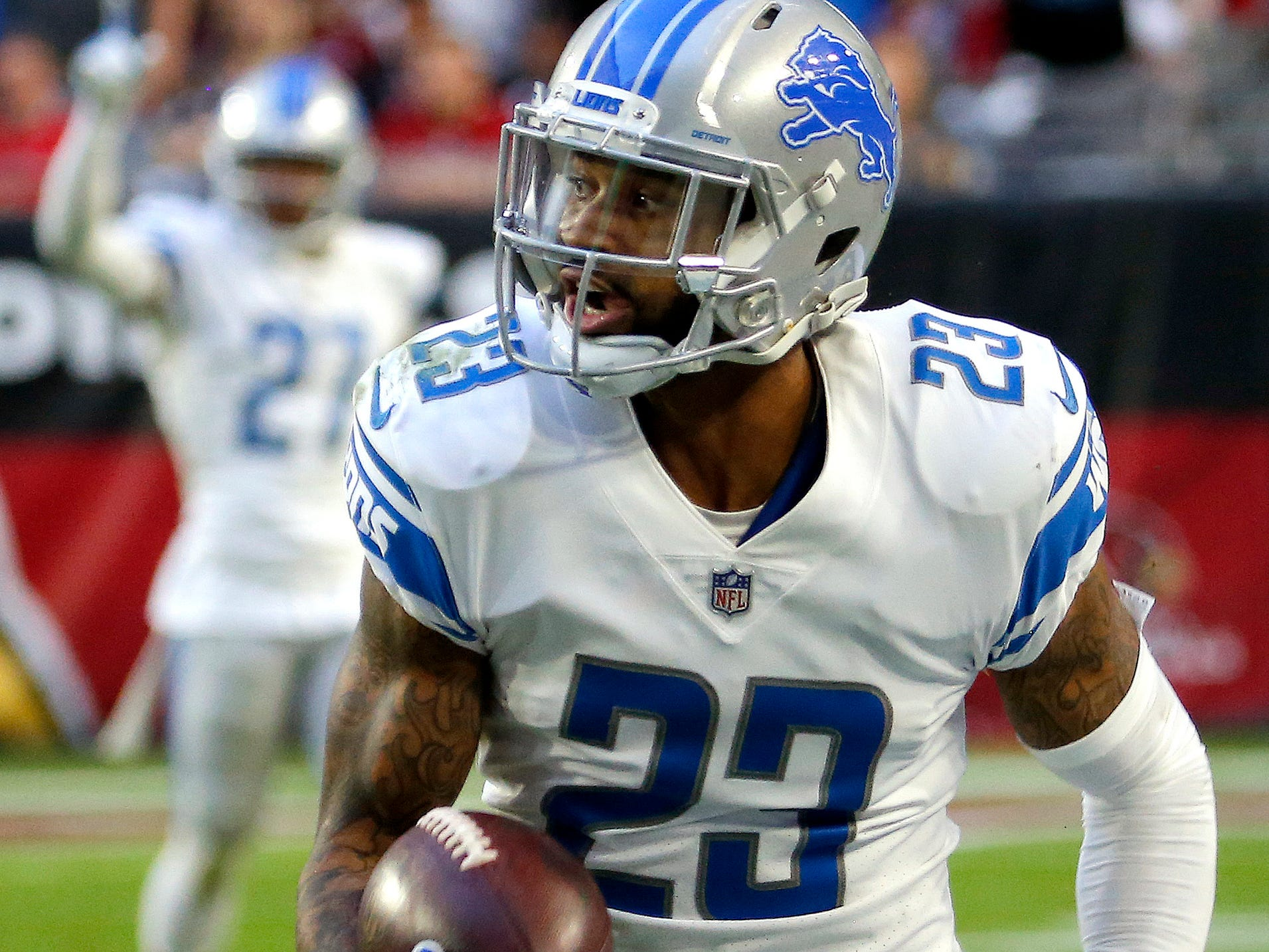 Detroit Lions cornerback Darius Slay (23) runs back his interception for a touchdown against the Arizona Cardinals during the second half of NFL football game, Sunday, Dec. 9, 2018, in Glendale, Ariz. Detroit defeated Arizona 17-3.