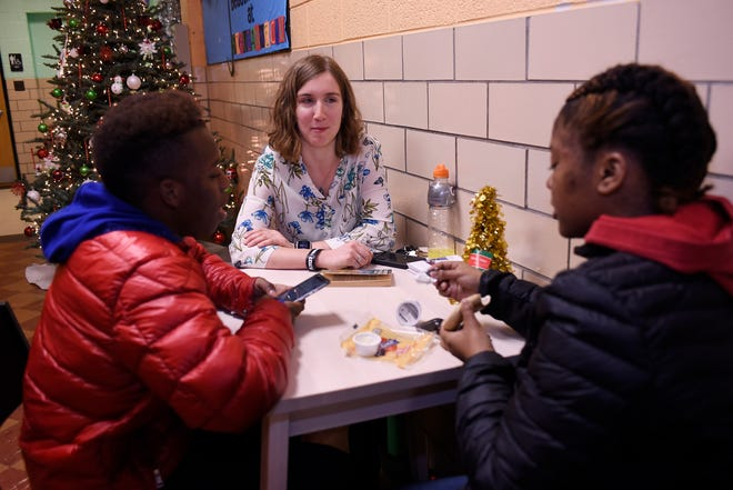 Volunteer Katie Little, 24, talks to Allen Smith, left, 14, and Lillie Reynolds-Smith, 16, both of Detroit, at the St. Suzanne Cody Rouge Community Resource Center, where she is an assistant manager. Little works with Christ the King Service Corps, which is receiving one of the first grants offered by the Catholic Foundation of Michigan.