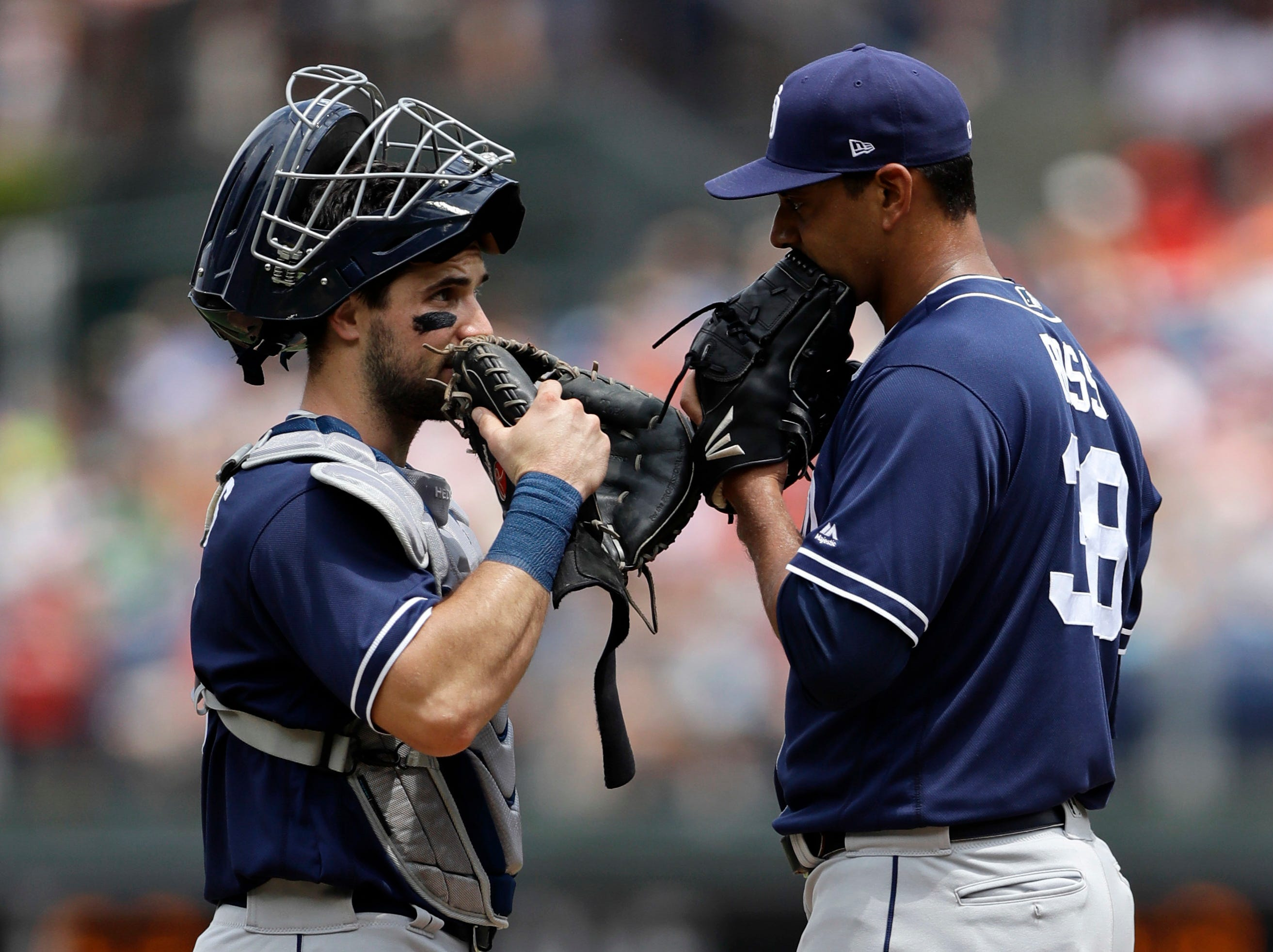 San Diego Padres catcher Austin Hedges, left, and starting pitcher Tyson Ross talk on the mound during the first inning of the first game in a doubleheader against the Philadelphia Phillies, Sunday, July 22, 2018, in Philadelphia.