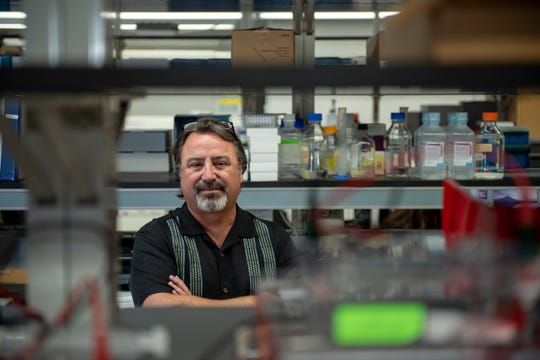 Dr. Gary Smith, director of the Reproductive Sciences Program at the University of Michigan, stands inside his lab, in Ann Arbor, November 5, 2018.