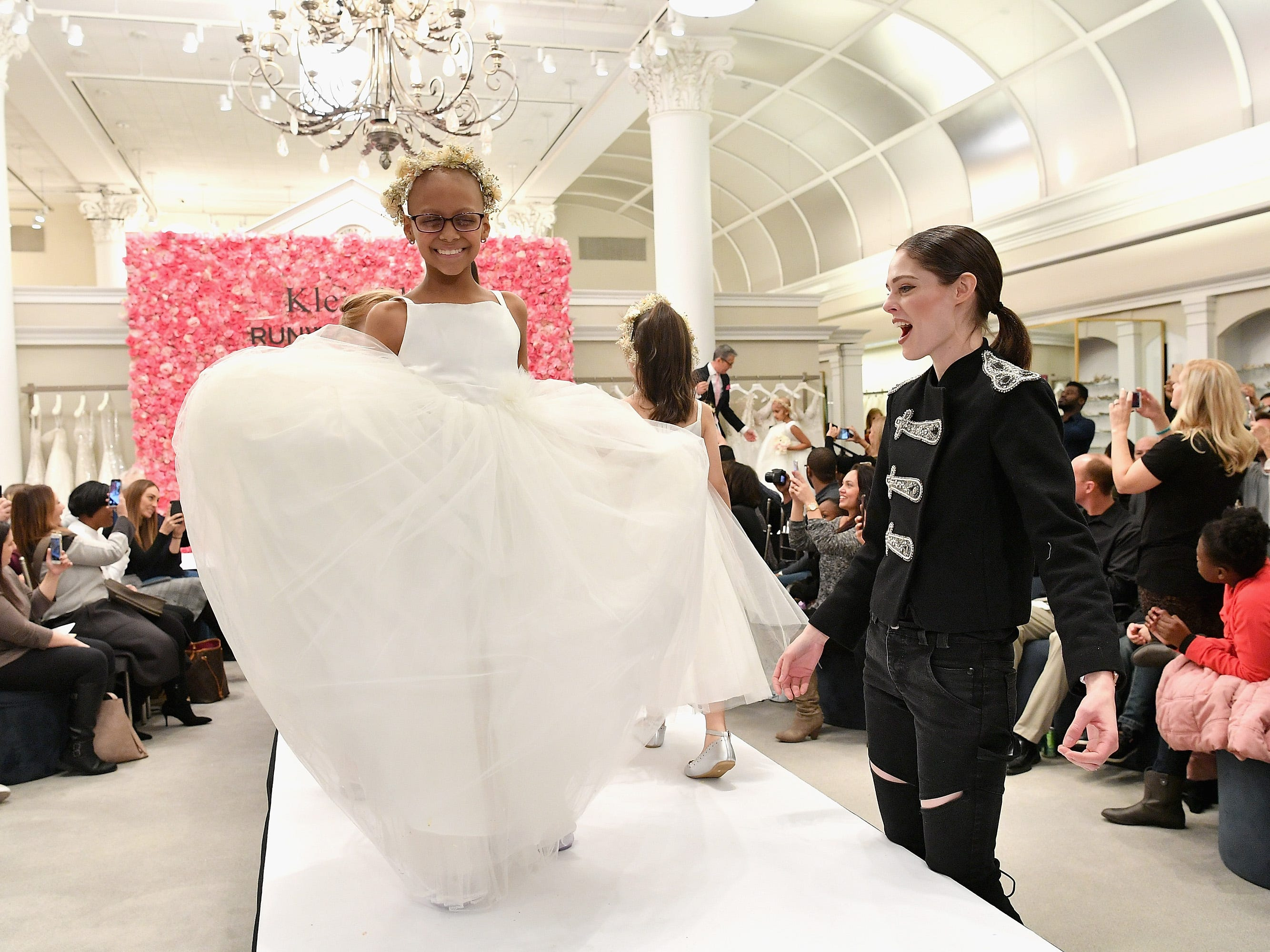 Model Coco Rocha cheers on childhood cancer fighters and survivors as they walk the runway during  Runway Heroes to Benefit Childhood Cancer Research at Kleinfeld on December 10, 2018, in New York City.