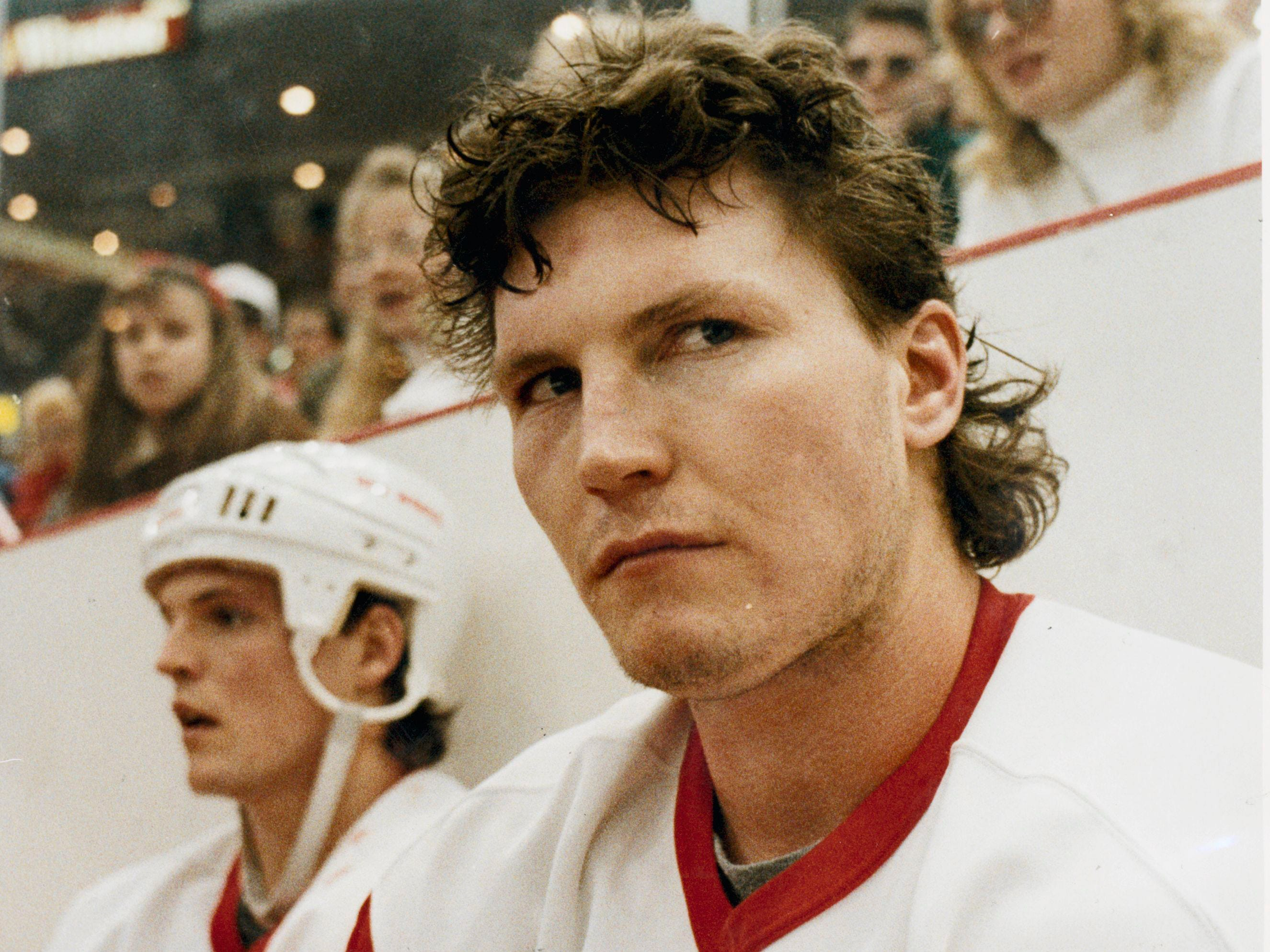 Red Wings player Bob Probert sits in the penalty box