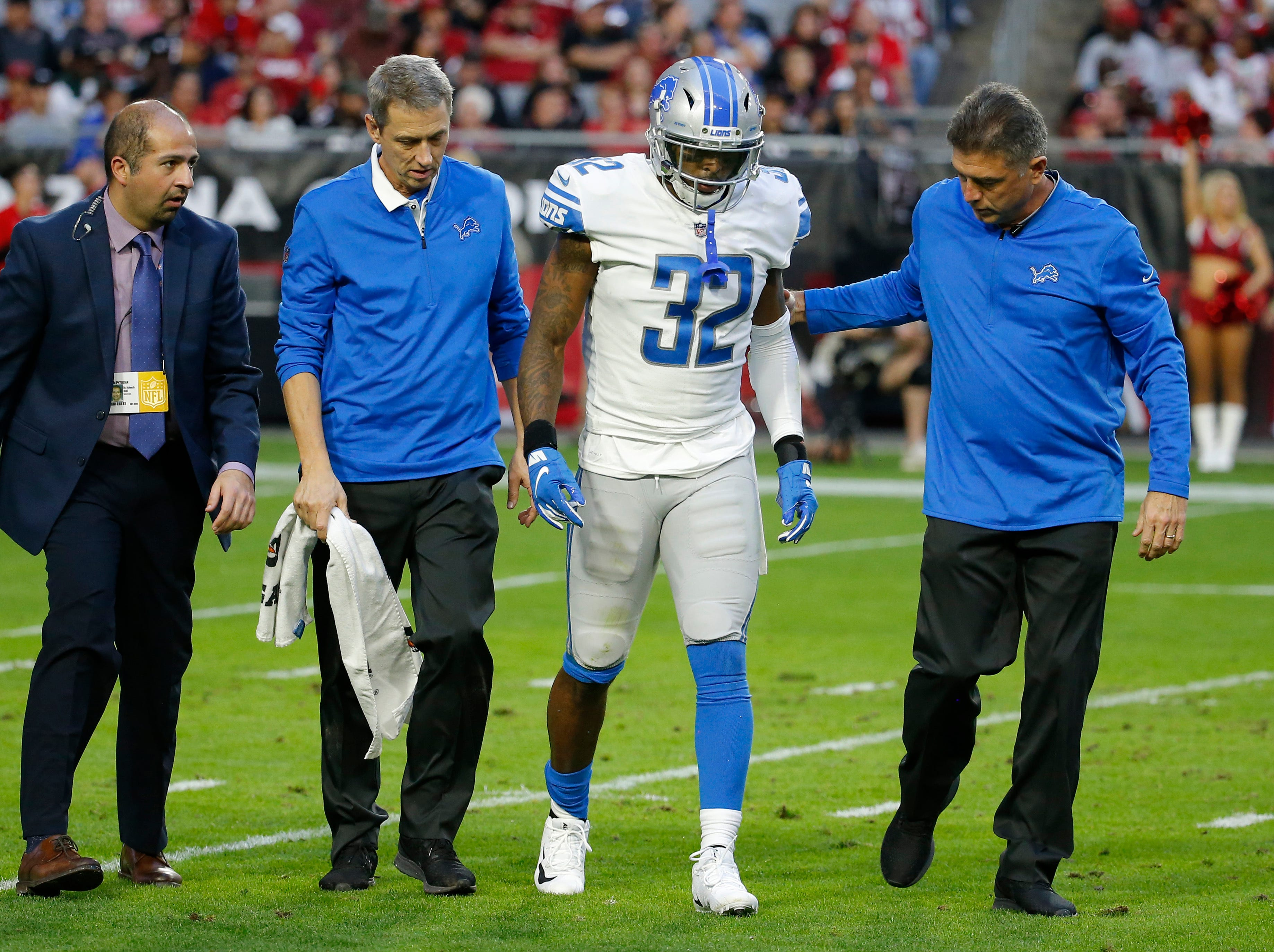 Detroit Lions defensive back Tavon Wilson (32) is helped after an injury against the Arizona Cardinals during the second half.