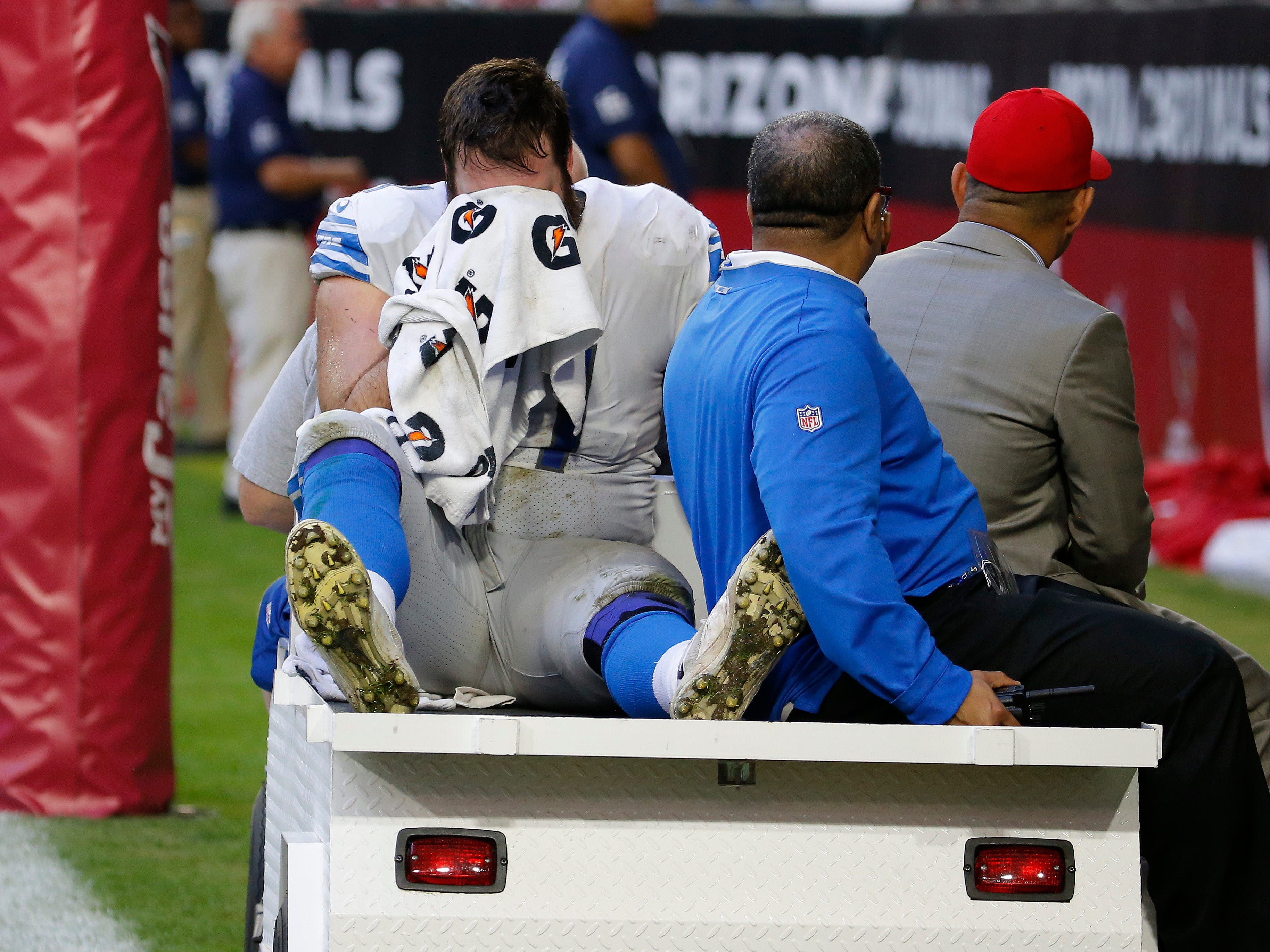 Detroit Lions offensive tackle Rick Wagner leaves the field after an injury against the Arizona Cardinals during the first half.