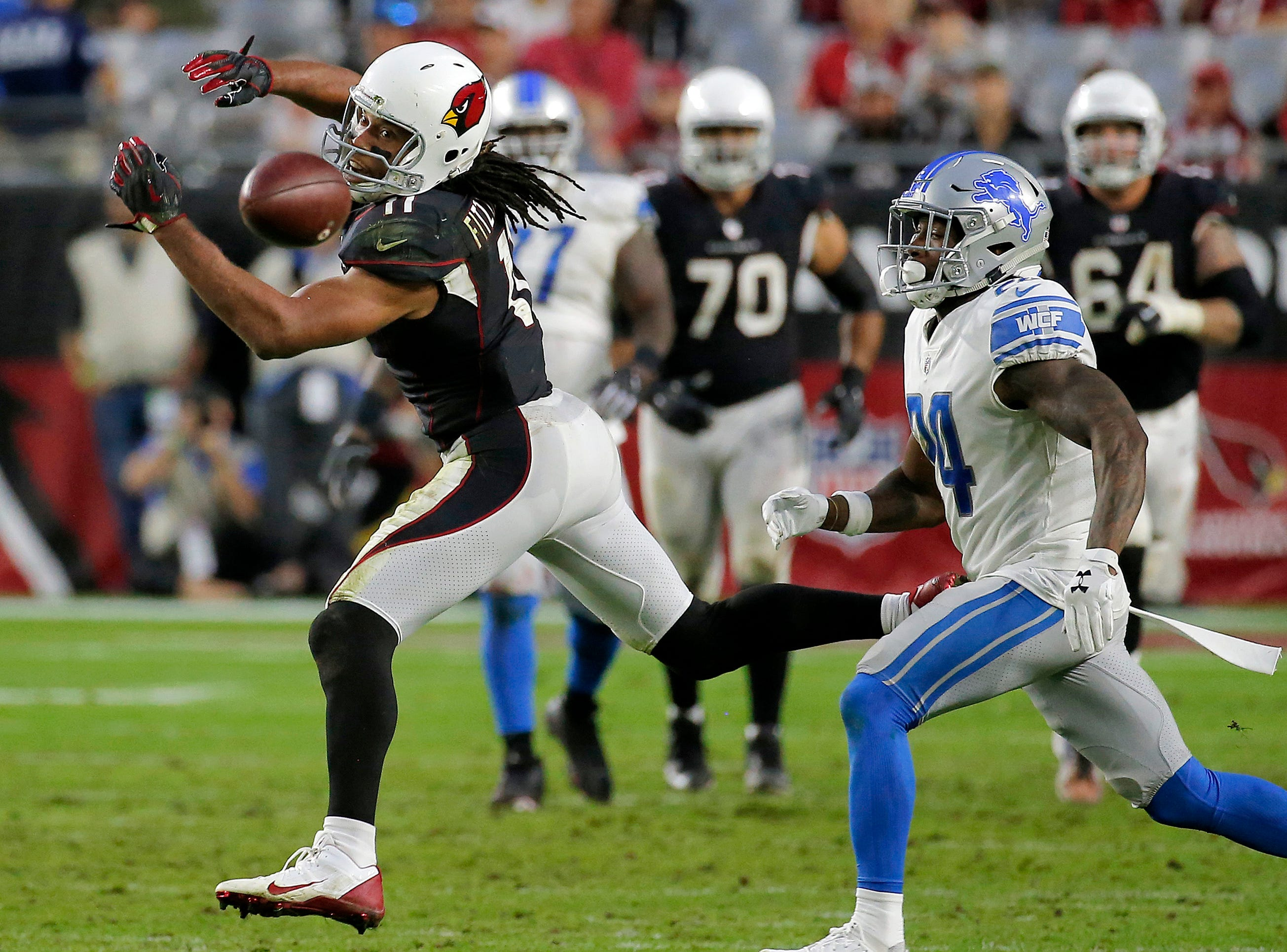 Arizona Cardinals wide receiver Larry Fitzgerald (11) can't make the catch against the Detroit Lions during the second half.
