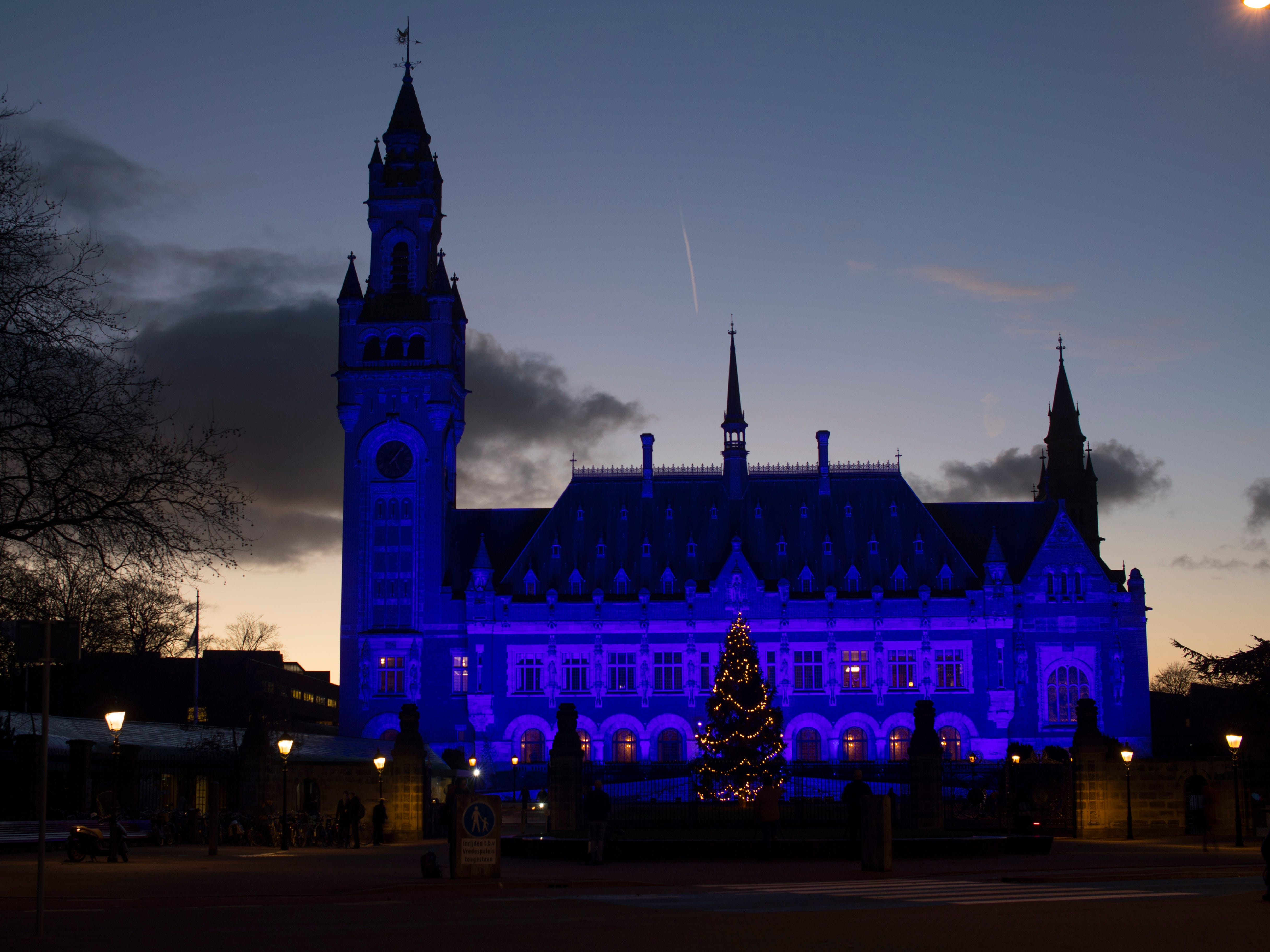 The Peace Palace, which houses the International Court of Justice, (ICJ), is illuminated in blue light in The Hague, Netherlands, Monday, Dec. 10, 2018, in support of the global campaign of Human Rights Watch which draws attention to human rights and human rights violations worldwide. Thirty landmarks across the globe will shine bright blue on December 10, 2018, to celebrate Human Rights Day and the 70th anniversary of the Universal Declaration of Human Rights.
