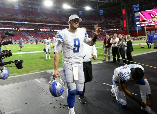 Detroit Lions quarterback Matthew Stafford leaves the field after the Lions beat the Cardinals.